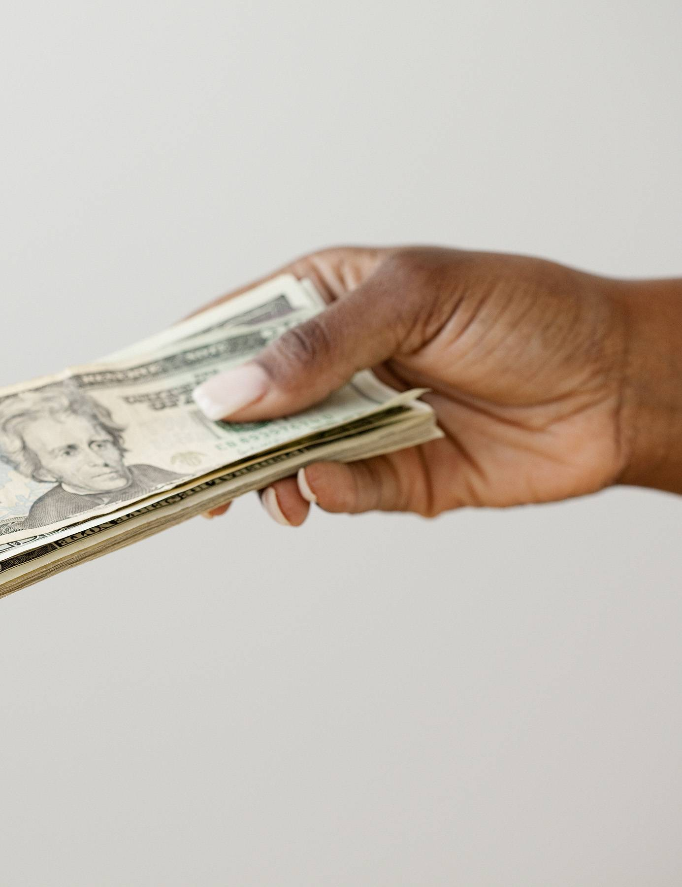 6.Handing Out Pamphlets - Well, those are dollar bills, but a pamphlet is a lot like money in that it can guide you toward achieving success.  (Photo: JGI/Jamie Grill/Blend Images)