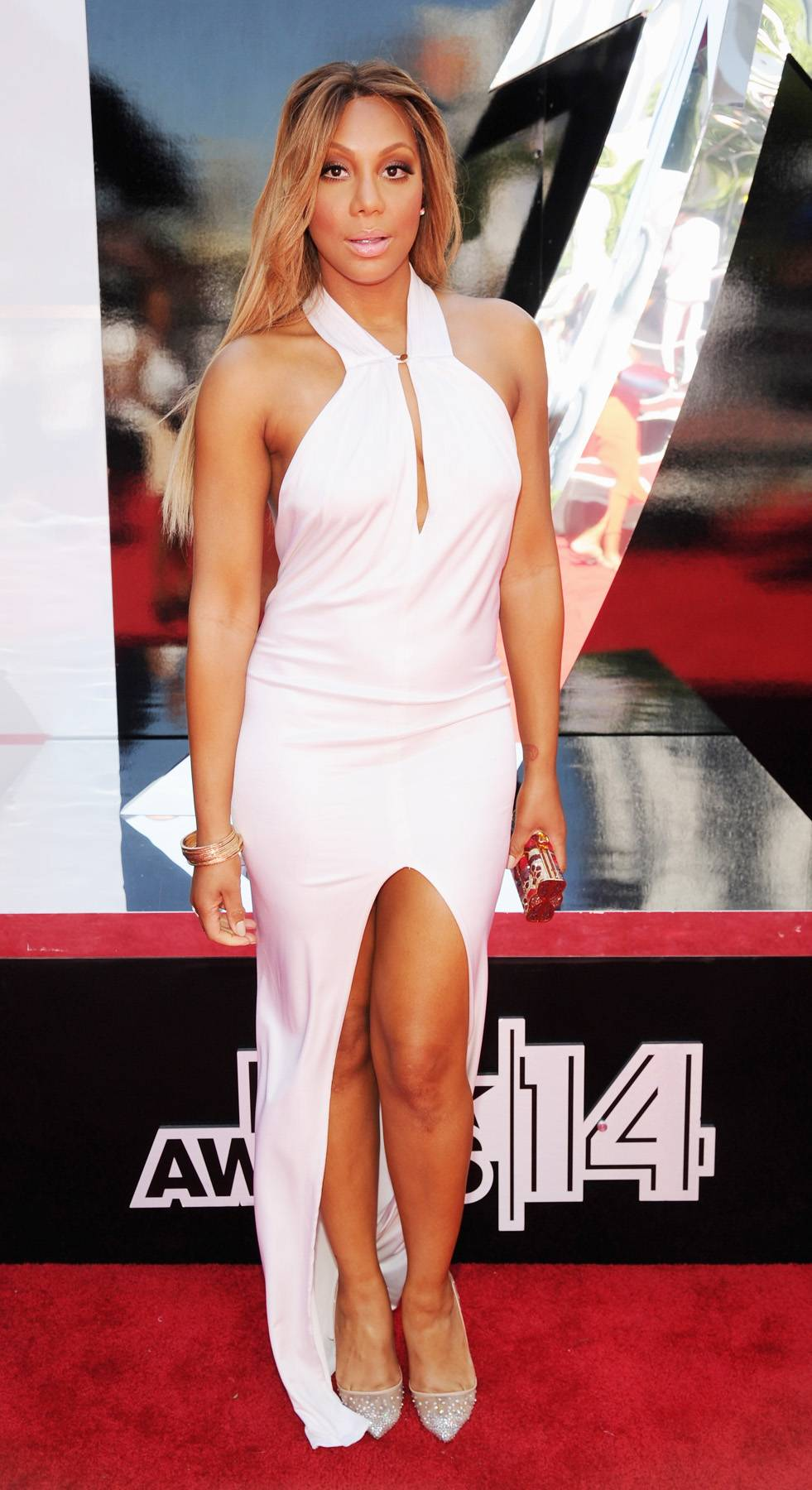 Tamar Braxton - The singer turns heads in her flow-y, ivory Michael Costello gown.  (Photo: Kevin Mazur/BET/Getty Images for BET)