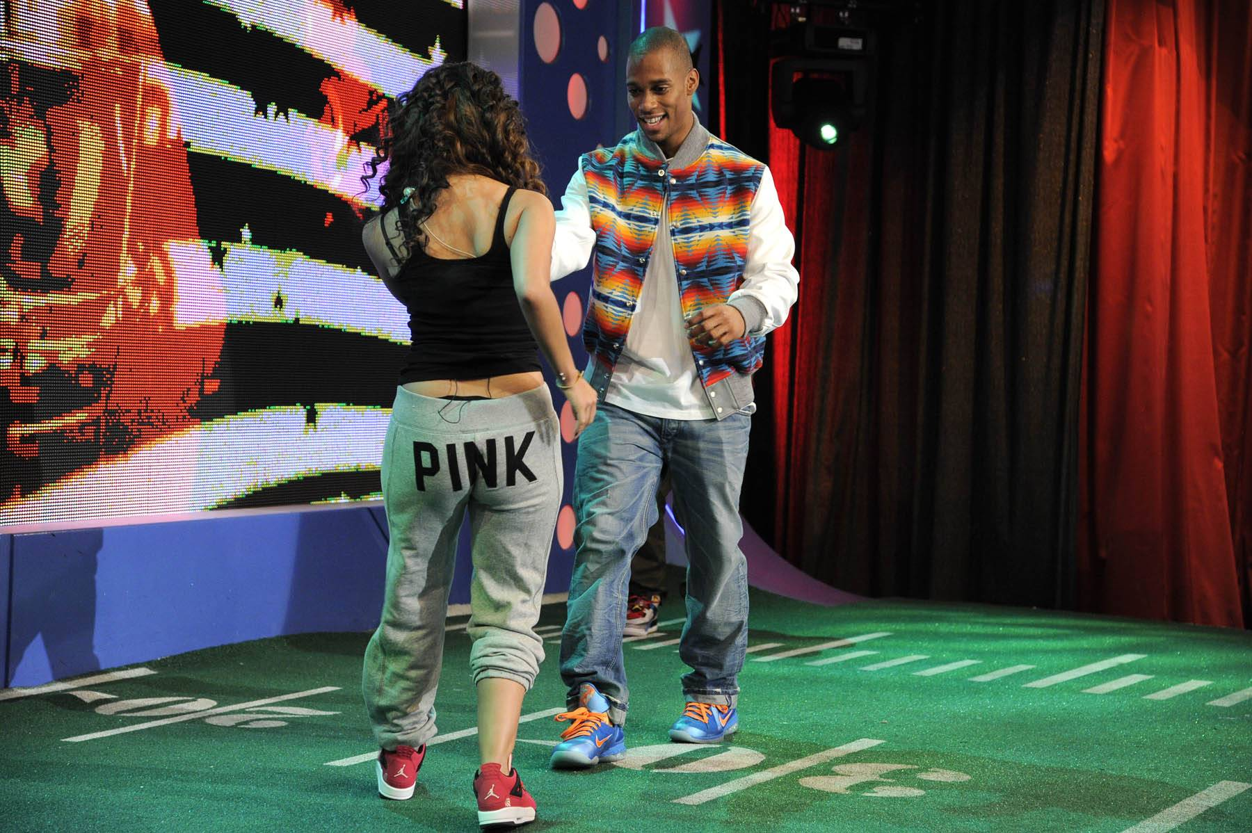 Who Won? - Rocsi Diaz entices Victor Cruz to join her in dancing the salsa at 106 & Park, January 26, 2012. (Photo: John Ricard / BET)