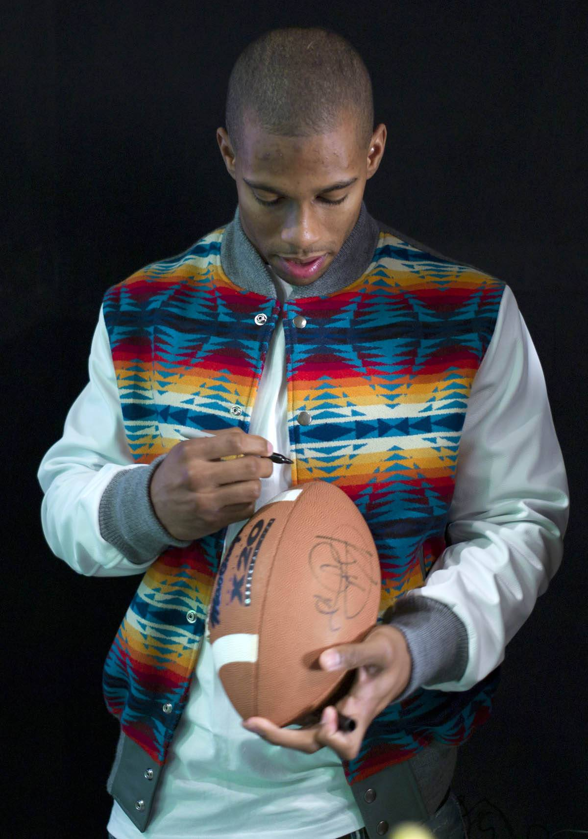 Sign This, Please - Victor Cruz signs an autograph at 106 & Park, January 26, 2012. (Photo: John Ricard / BET)