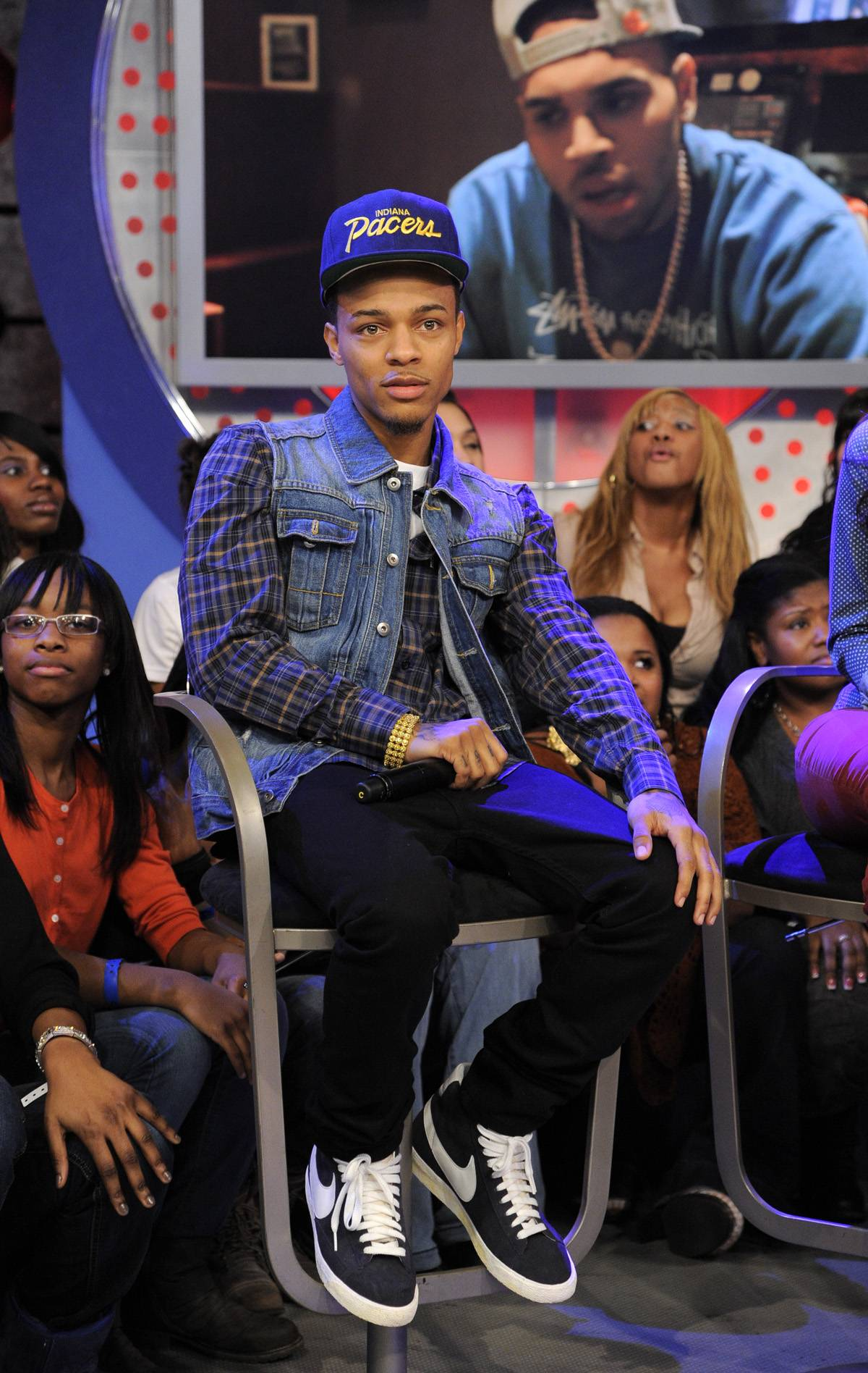 Salute - Bow Wow listens as a video salute to him from Chris Brown plays at 106 & Park, January 23, 2012. (Photo: John Ricard / BET)