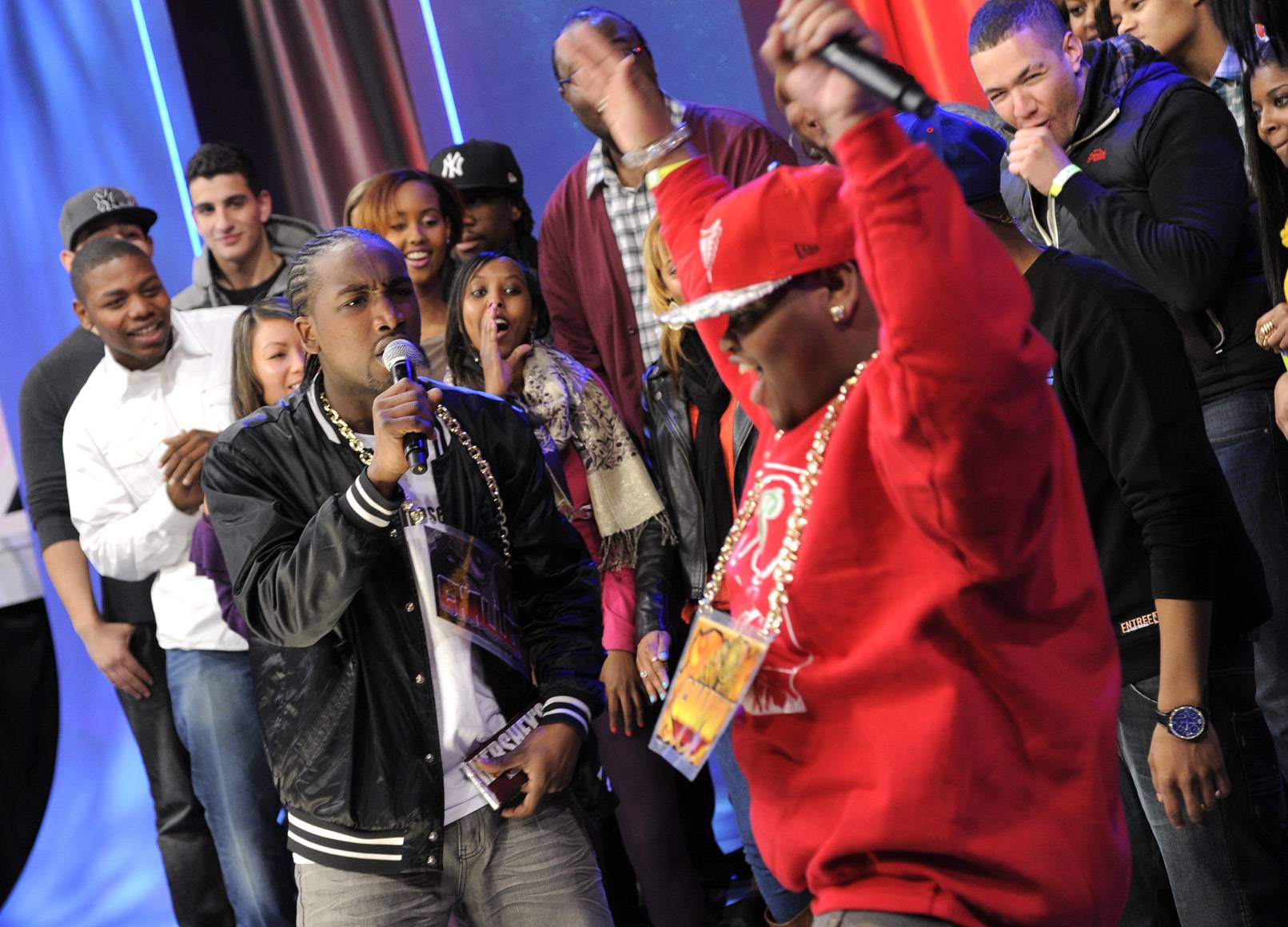 Hands Up - Sensing victory, Relly celebrates as Dolo Chillin delivers his second verse at 106 & Park, January 20, 2012. (Photo: John Ricard / BET)