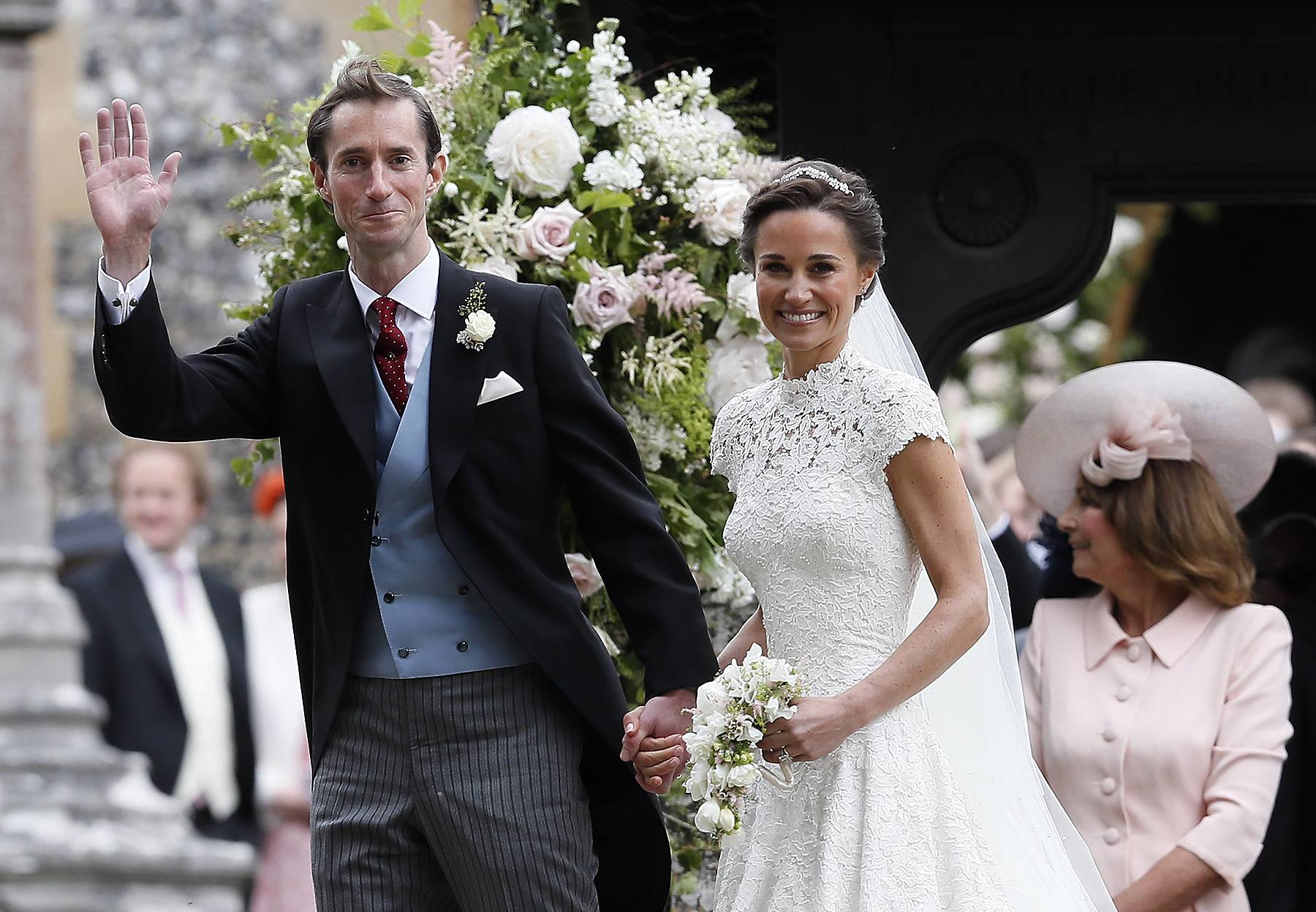 Pippa Middleton and James Matthews smile for the cameras after their wedding at St Mark's Church on May 20, 2017 in Englefield, England. Middleton, the sister of Catherine, Duchess of Cambridge married hedge fund manager James Matthews in a ceremony Saturday where her niece and nephew Prince George and Princess Charlotte was in the wedding party, along with sister Kate and princes Harry and William. (Photo: Kirsty Wigglesworth - Pool/Getty Images)