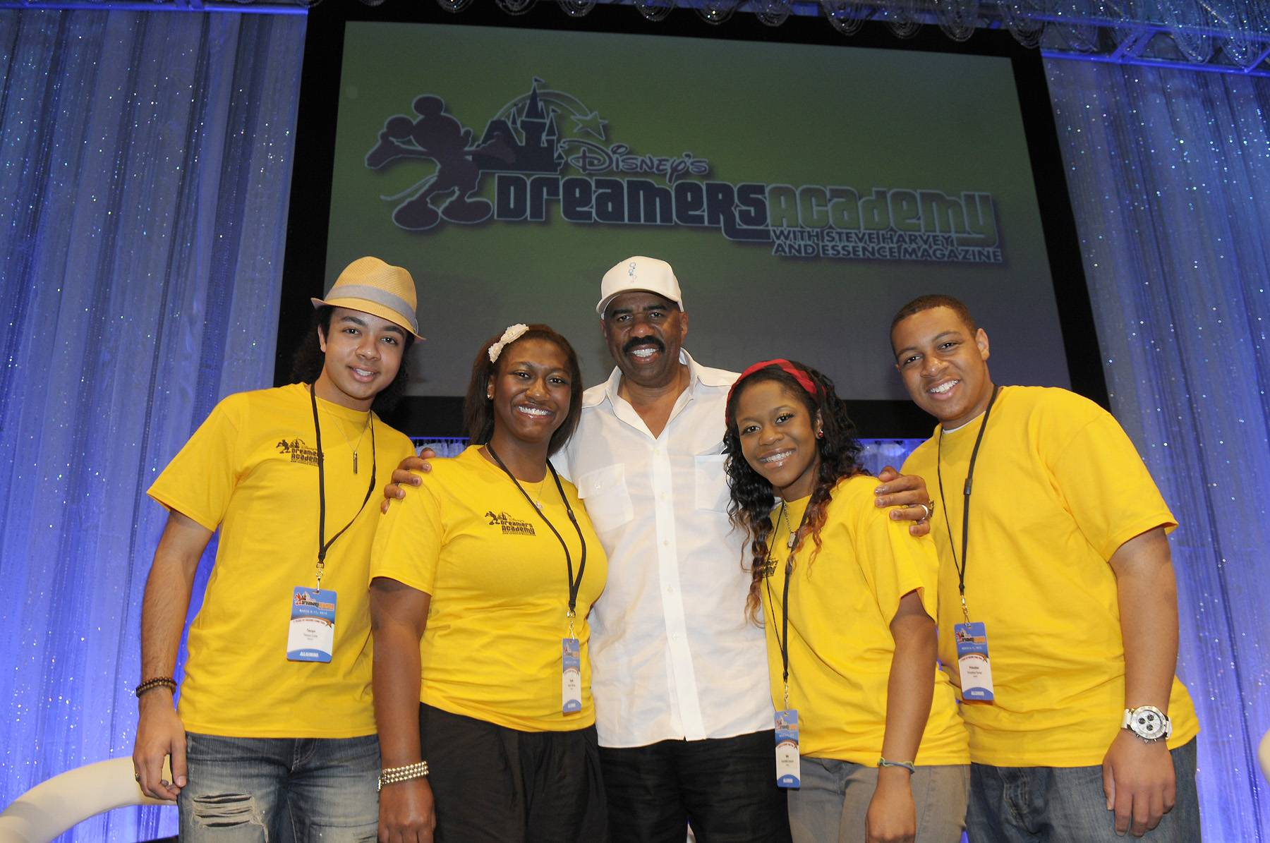 Bright Futures - The Dreamers Academy took place in Orlando, FL March 8-11. Radio personality, comedian and author Steve Harvey once again hosted the academy, as he has since it began in 2007. Here, he poses with four Dreamers Academy guests, including Nikki Dawson (left, center), who competed last season on The Voice.   (Photo: Phelan Ebenhack)