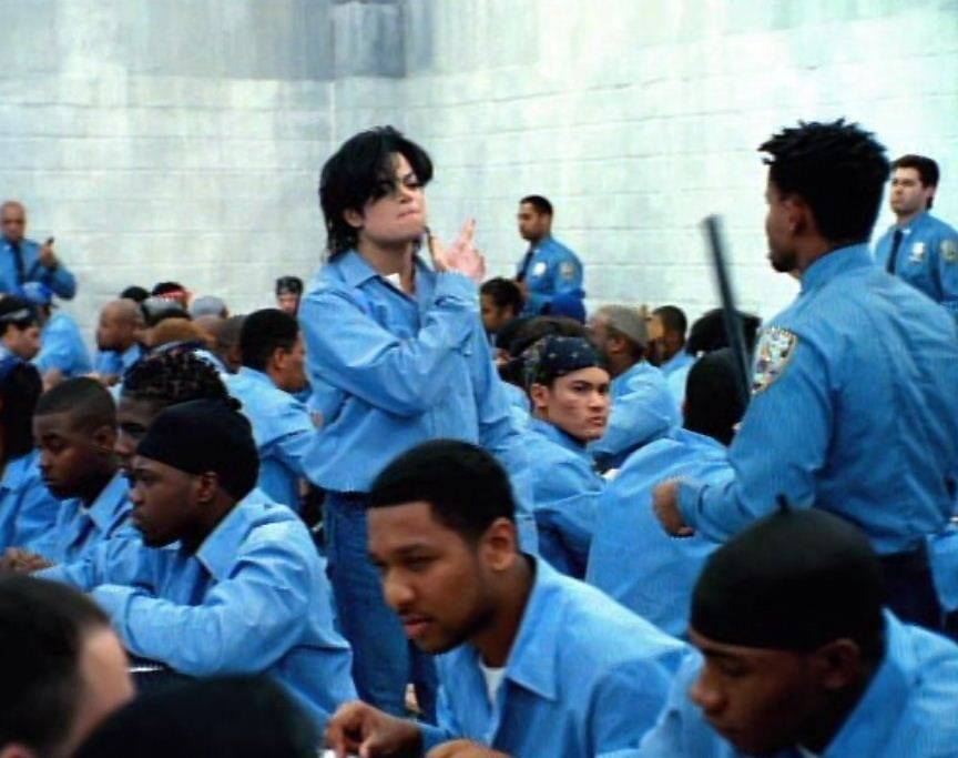 """Michael Jackson: """"They Don't Care About Us"""" - When MJ wanted to film his music video for """"They Don't Care About Us,"""" he had two versions made: one prison-themed video and one of him getting funky in Brazil. He went to Leeforthe now classic clip in Brazil.  (Photo: Epic Records)"""
