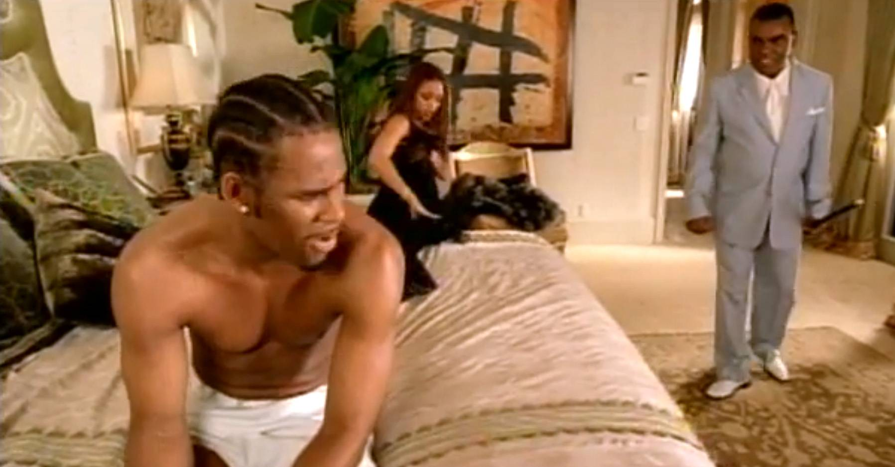 """Ron Isley (Mr. Biggs), R. Kelly and Chante Moore in """"Contagious"""" - In 2001, Ron Isley made a comeback and recruited none other than R. Kelly and Chante Moore to appear alongside him on this sordid song about discovering your spouse's infidelities. The part where Isley (who is referred to by his alias, Mr. Biggs) discovers his wife cheating ranks as one of the greatest moments in R&B history. Even better, the video and lyrics refer to Ron Isley and R. Kelly's previous collaborations, """"Down Low"""" and """"Friend of Mine"""" (remix).   (Photo: SKG Music LLC)"""