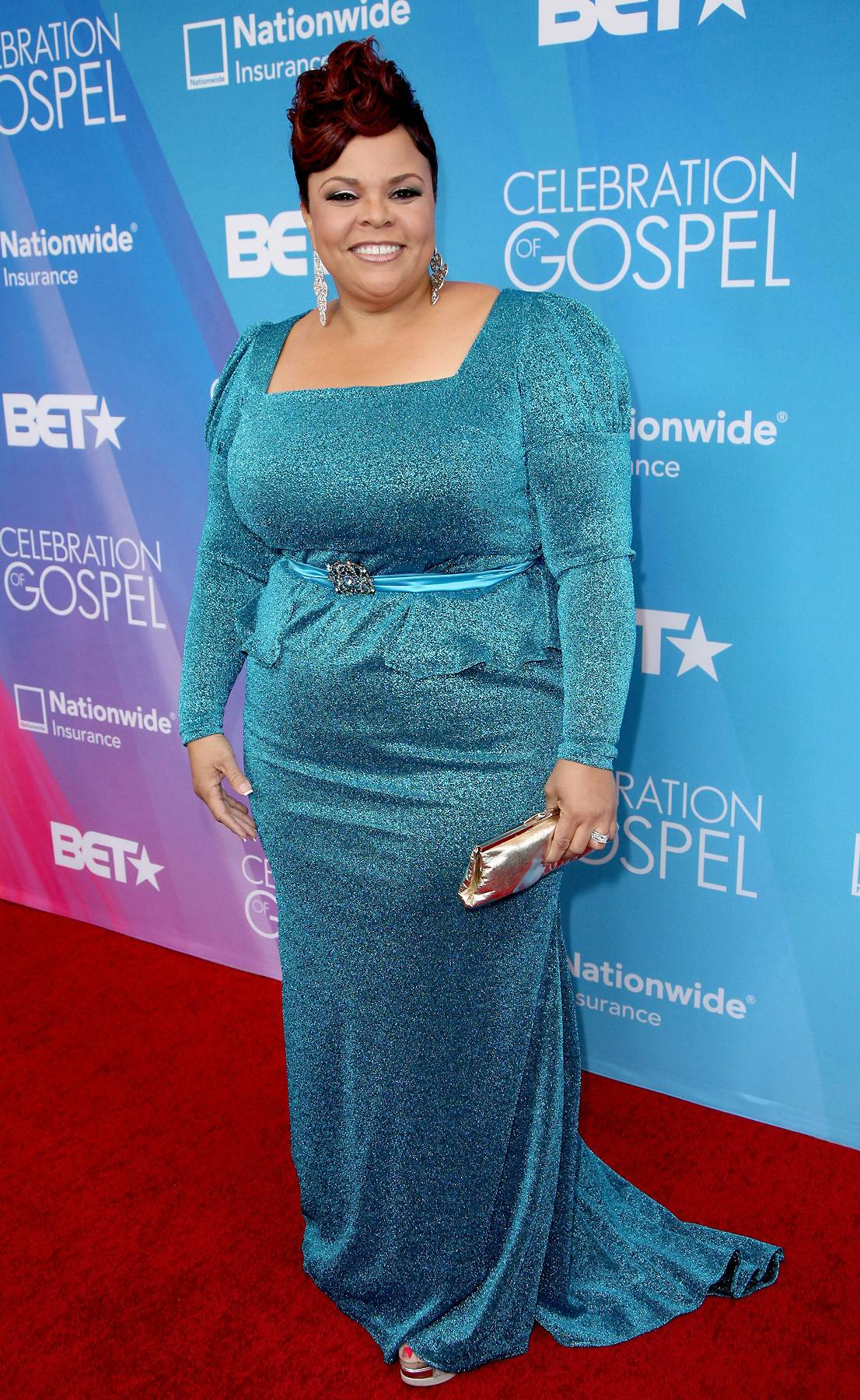 """To The King - Before bringing the house down with her stirring rendition of """"Take Me To The King,"""" Tamala Mann looks absolutely flawless in her cerulean blue dress.(Photo: Maury Phillips/Getty Images for BET)"""
