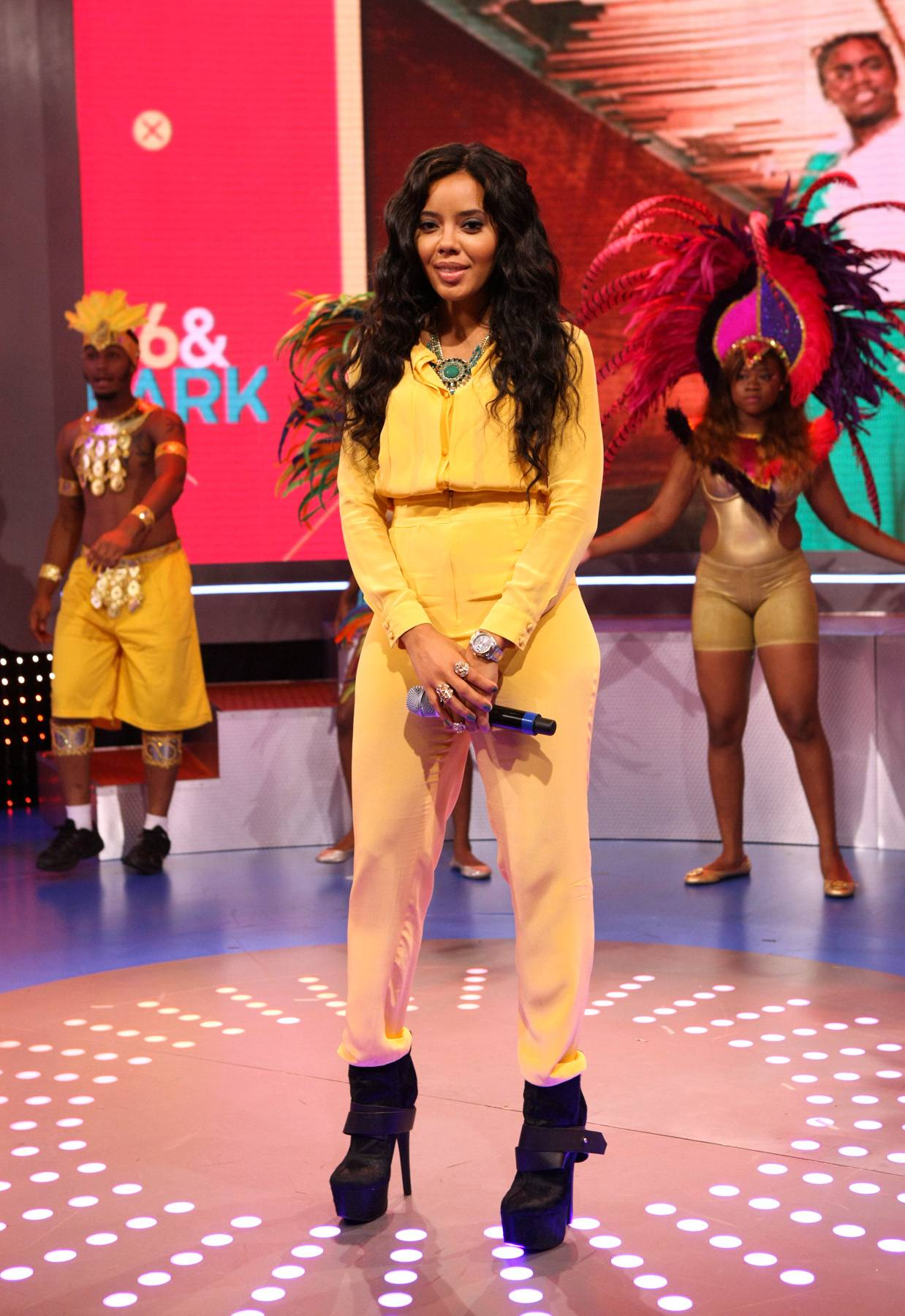 Mellow Yellow - For the 106 Carnival special at the end of August, Angela Simmons rocked a tough yellow jumpsuit with a great green necklace and killed it! (Photo: Bennett Raglin/BET/Getty Images for BET)