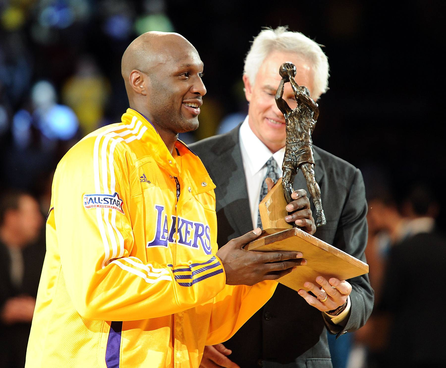 Sixth Man of the Year Award and Personal Issues - Odom continued to rack up career highs with the Lakers in the 2010-2011 seasons. Averaging 14.4 points, 8.7 rebounds, 3.0 assists, Odom became the first Laker to win the Sixth Man of The Year Award. Following that season, the star reportedly contemplated quitting the NBA when his cousin was killed, and he himself was involved in a car accident which killed a cyclist.(Photo: Harry How/Getty Images)