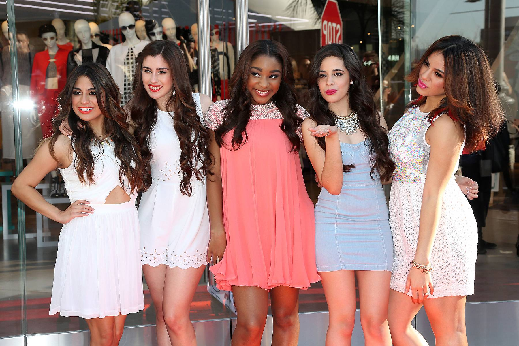 """Fifth Harmony - September 22, 2014 - Mega group Fifth Harmony paid us a visit and performed their latest hit, """"Bo$."""" Watch a clip now!  (Photo: Frederick M. Brown/Getty Images)"""