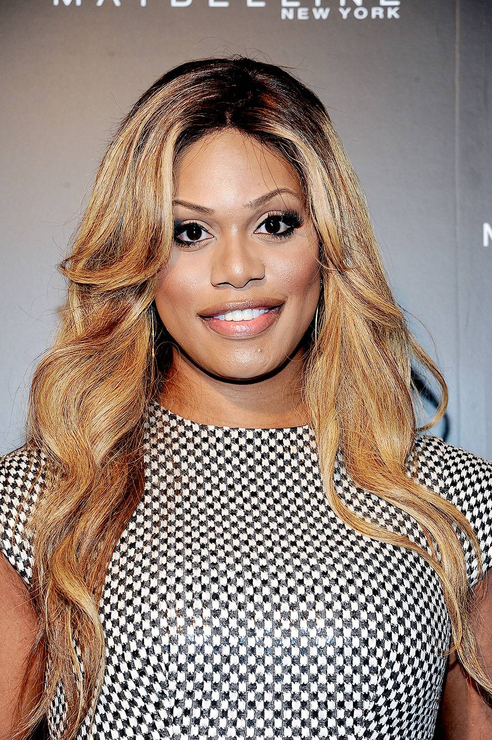 Laverne Cox - The Orange Is the New Black star is hip to the season?s hottest trend; rich color. For fall, her signature blonde is warmed up with honey and caramel tones that are universally flattering on brown skin.  (Photo: Rommel Demano/Getty Images)