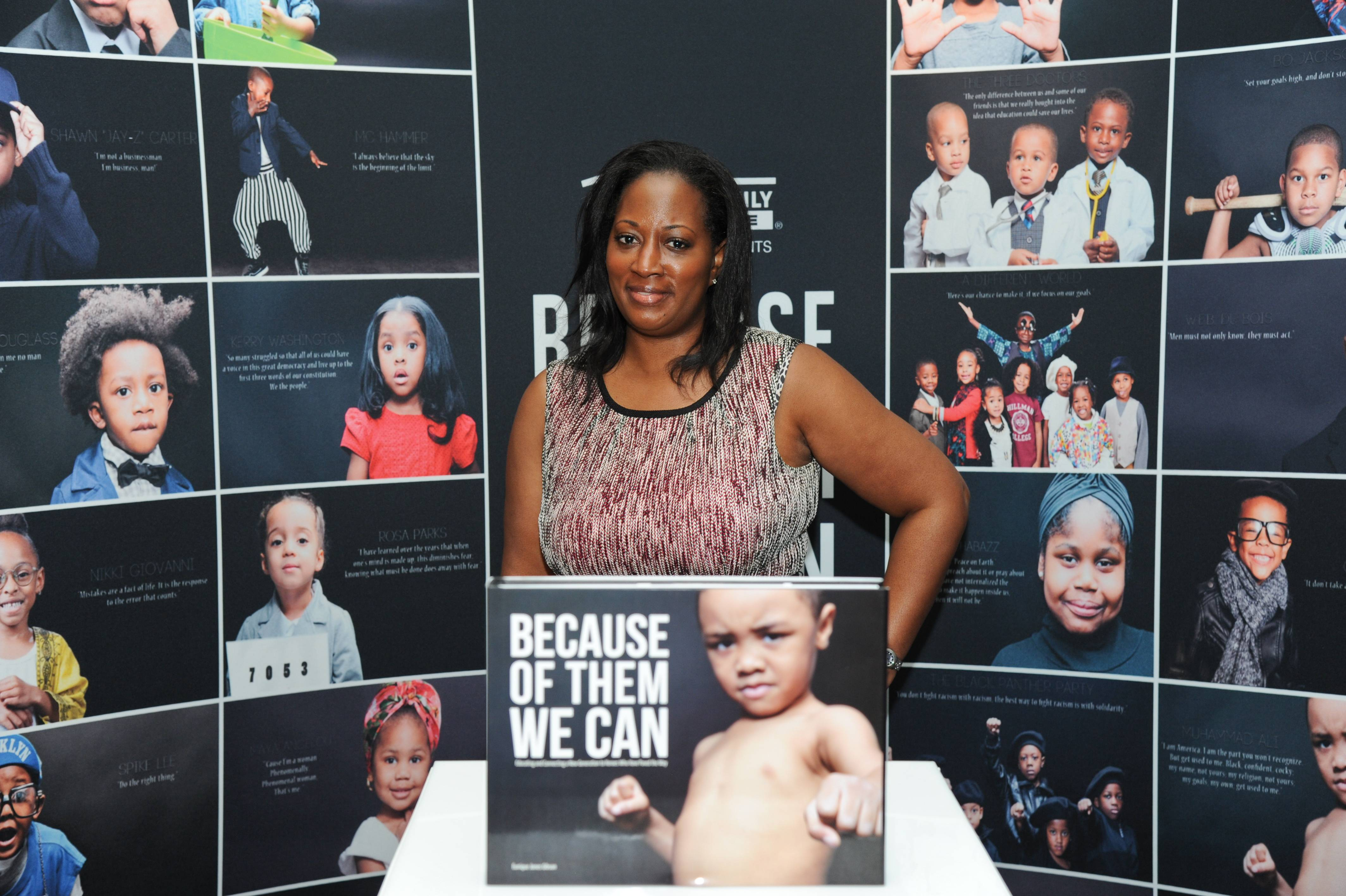 """Power in Pictures - Friends visit the Dream Wall and take a peek at the """"Because of Them, We Can"""" coffee table book, which has an adorable boy (Eunique Jones' son) posing as Muhammad Ali on the cover.  (Photo: Vladimir Banjanac for BET)"""