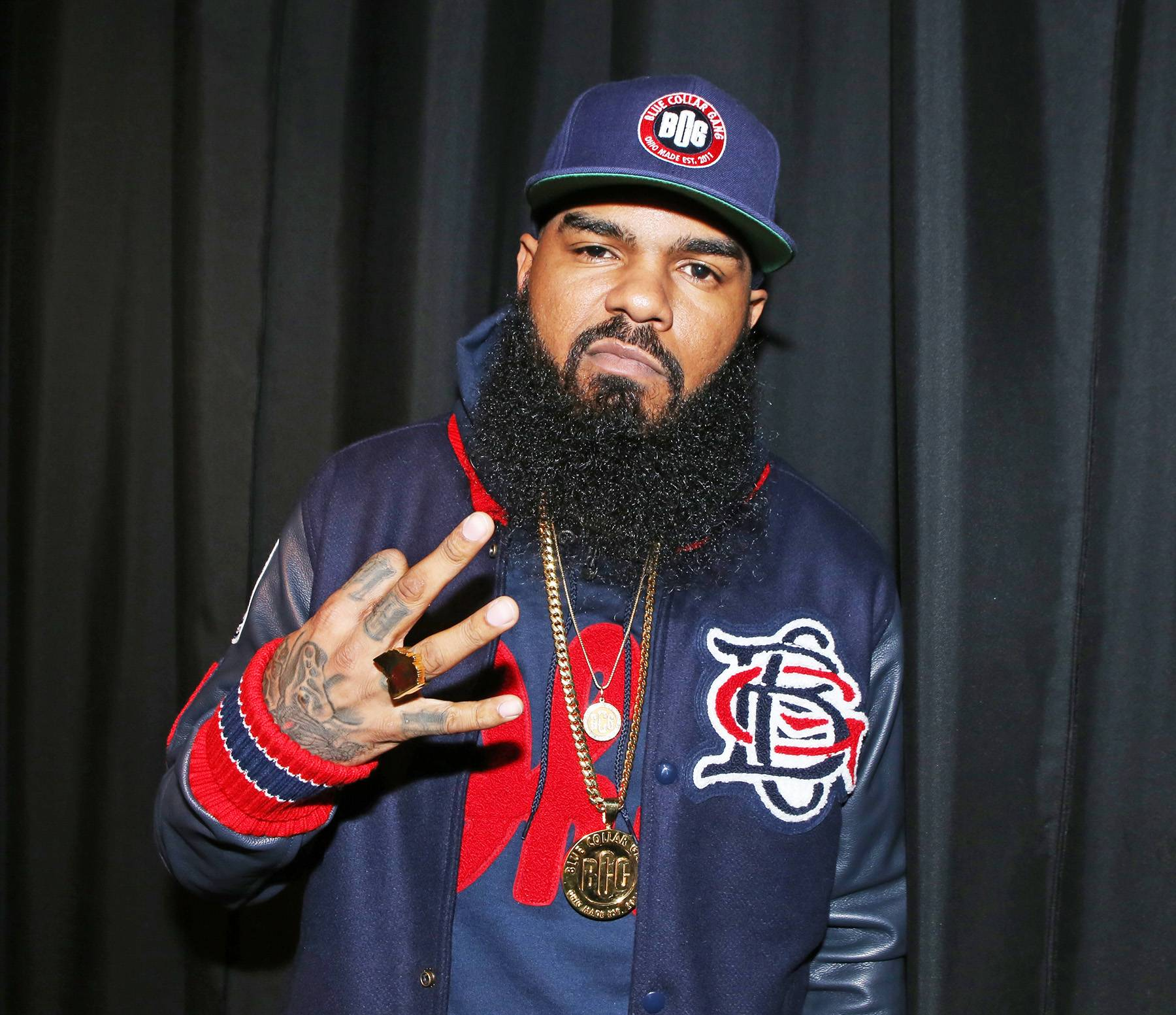 """Stalley Talks New Album - Recall Stalley gave listeners a chance to listen to his debut album, Ohio, at his West Coast-themed listening party a few weeks ago. Now, he?s dishing on the excitement of his album, what he wants listeners to get from it, and where he is going. ?I want the audience to grasp the originality behind it, because that?s important to me. I titled the album Ohio not only because of where I?m from, but it?s also an acronym for """"Over Here I?m Original."""" I was particular about this project. From the beat picking, the flow and the cadence I use in song.? Check out the rest of his interview with Vibe here.(Photo: Bennett Raglin/BET/Getty Images)"""