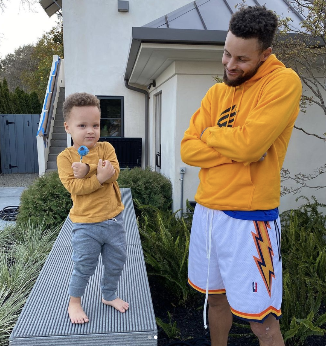 """Steph Curry - Steph Curry left fansswooning over this adorable photo with his 2-year-old son, Canon. The proud dad posed with his little guy after Canon received his first haircut. Mama Ayesha took the photo of the duo with her caption reading, """"Baby boy got his first haircut and I can't deal 😭. My handsomes!!!!"""" How precious! (Photo: Ayesha Curry) Photo: Ayesha Curry"""