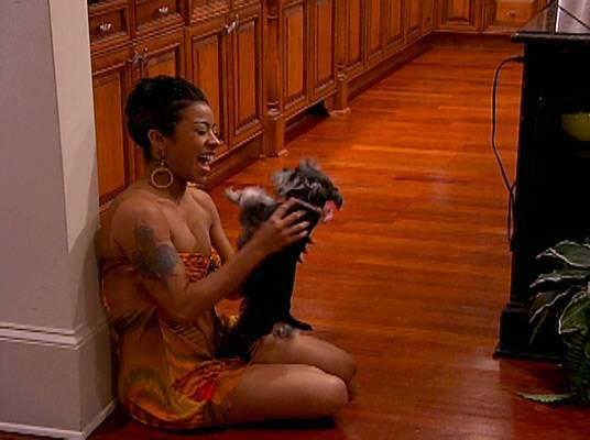 Keyshia Cole - Keyshia having playtime with her doggie.