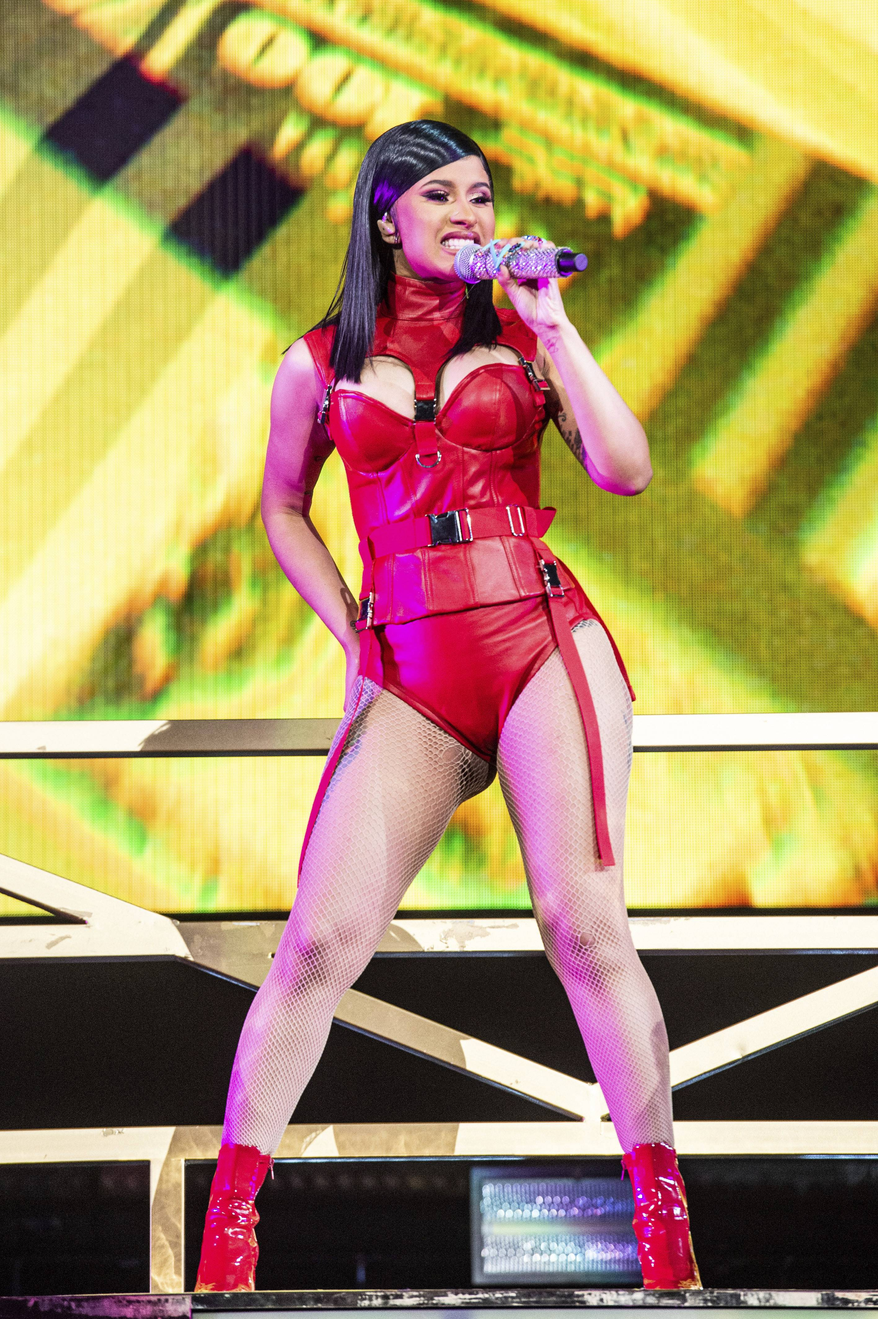 Red Barz - Cardi B came through drippin on the Indianopolis stage. She struted her staff and showcase her curves in a red, leather corset! (Photo: AP)