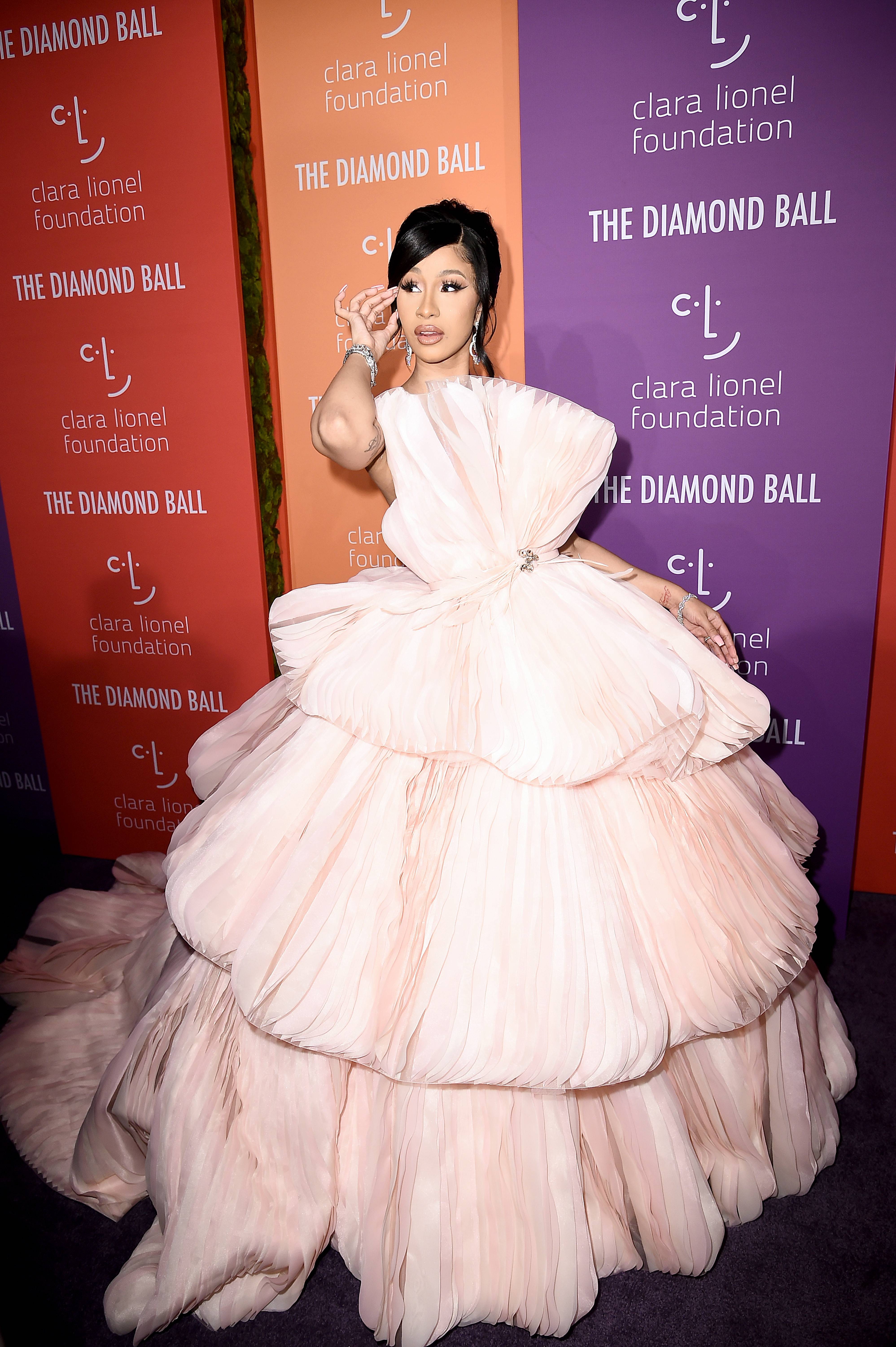Pretty In Pink! - Styled by Kollin Carter, Cardi B's Diamond Ball outfit was quite fitting! Shegraced carpetlooking like a poppin' princess wearing an enormous, light pink dress by Georges Hobeika, and of course diamonds by Lorriane Schwartz. (Photo: Steven Ferdman/Getty Images)