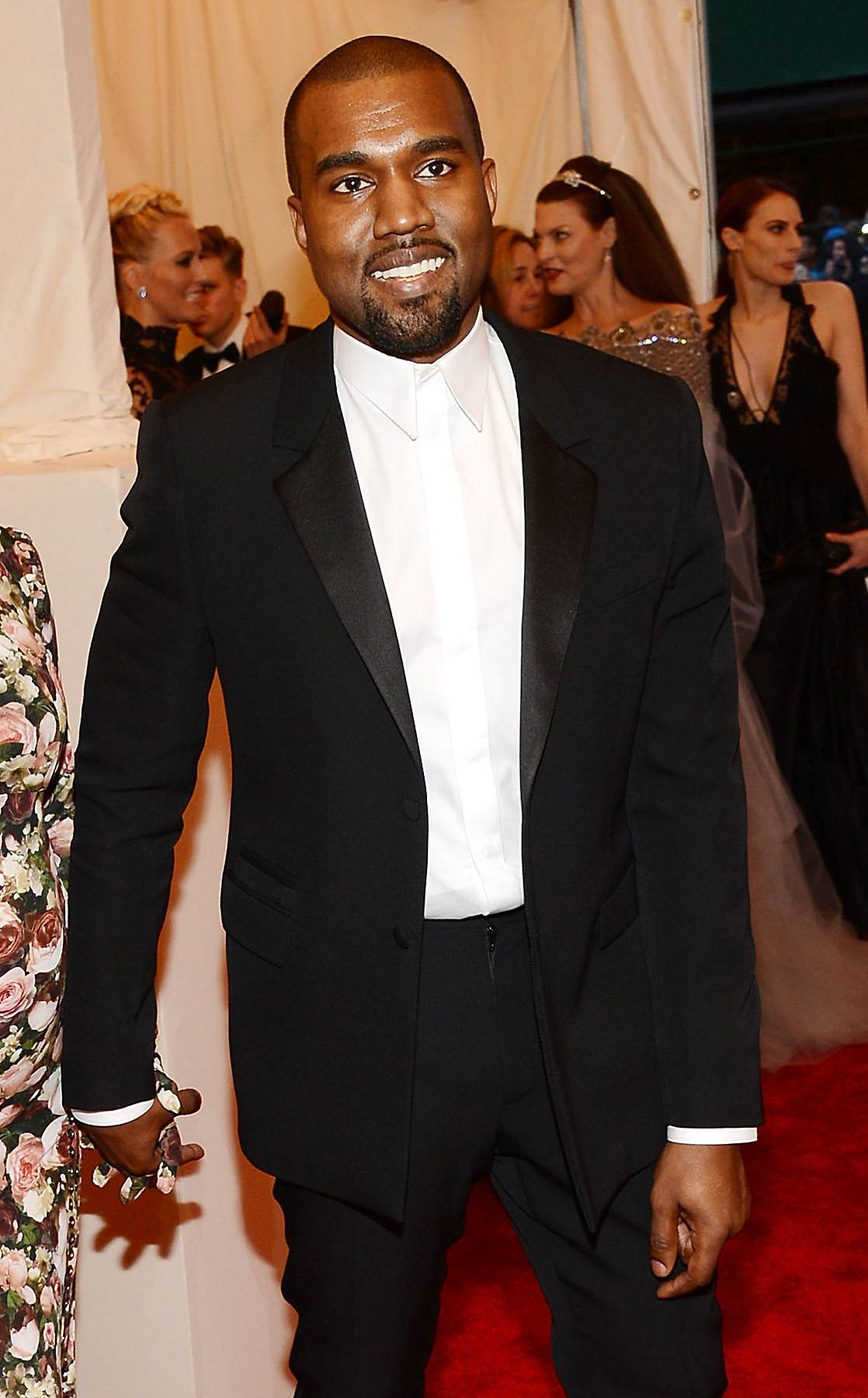 """Kanye West, 'Roses' - It's no secret that Yeezy adores the women in his life. The passionate track """"Roses"""" provided yet another example of that love as he pays homage to his grandma, who at the time was hospitalized.  Kanye: """"When they said that she made it / You see they eyes gleam / I think we at an all time high...Cause with my family we know where home is /And so instead of sending flowers, we're the roses.""""  (Photo: Larry Busacca/Getty Images)"""