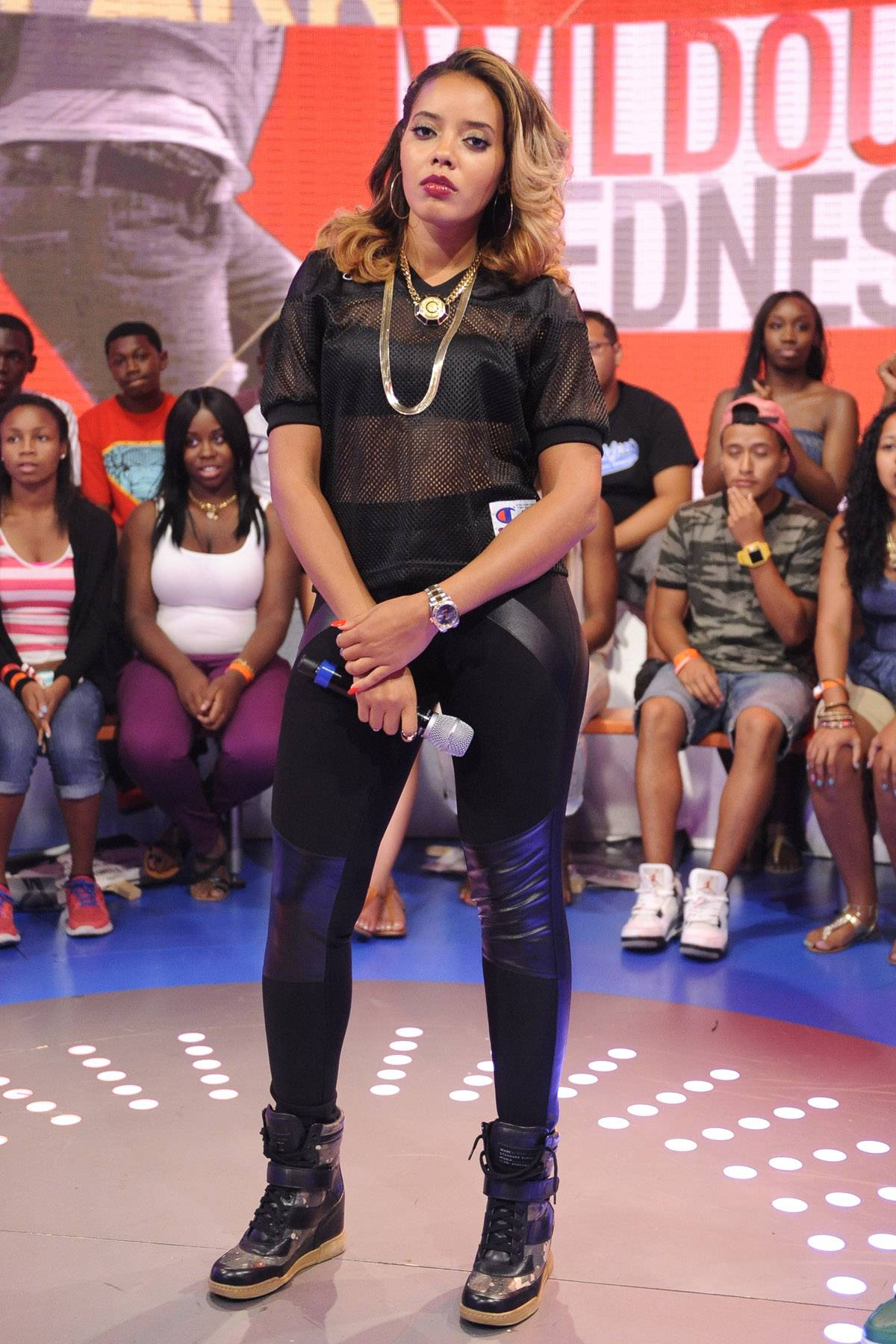 Sporty - Angela Simmons rocked an all-black sporty yet chic outfit with the football jersey top, leather leggings and platform sneakers. Get 'em, girl!  (photo: John Ricard / BET)