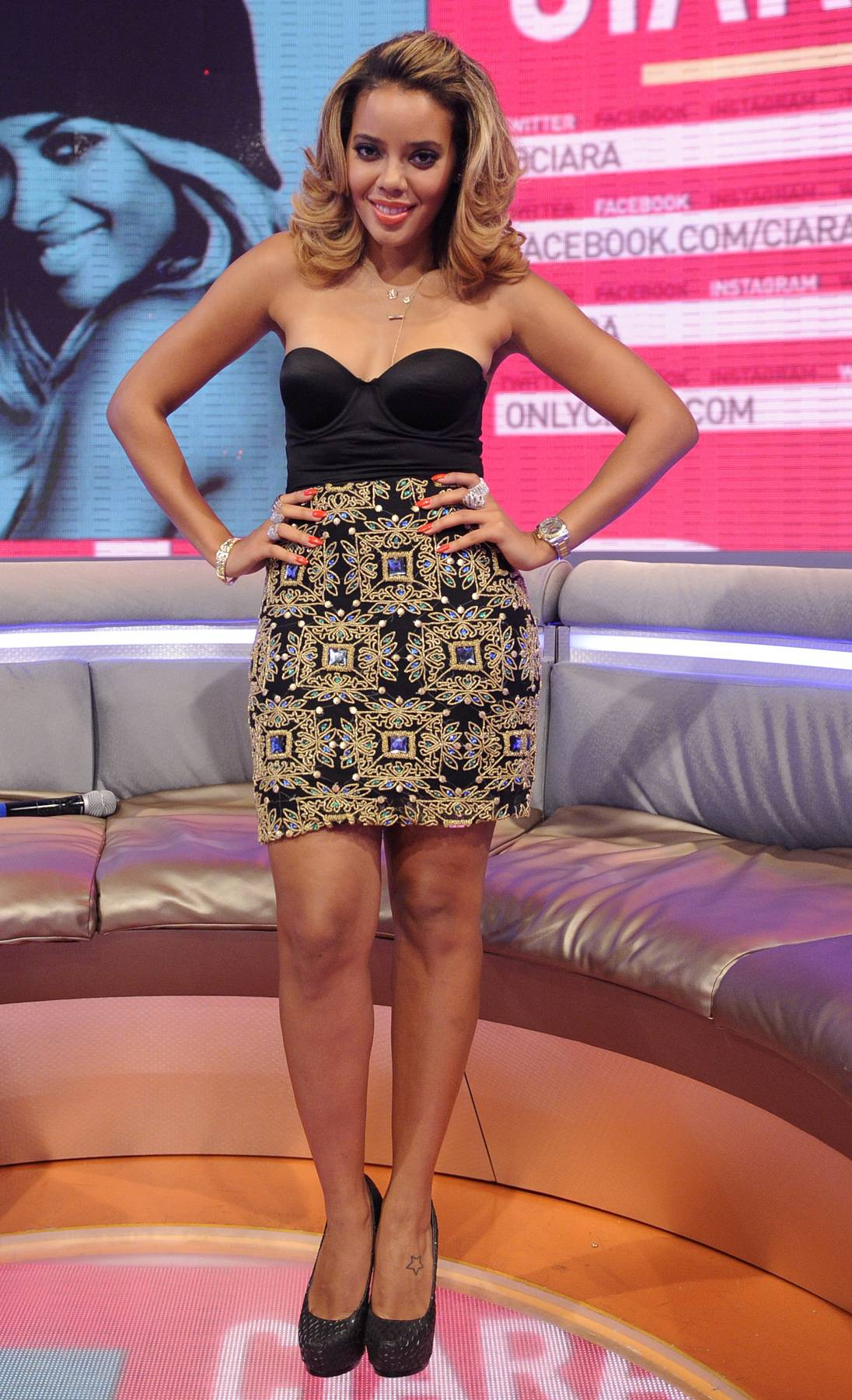 Kaleidoscope Dreams - One of our favorite Angela Simmons outfits is this one because her skirt has a kaleidoscope feel that brings a certain level of edge to what she's wearing. (photo: John Ricard / BET)