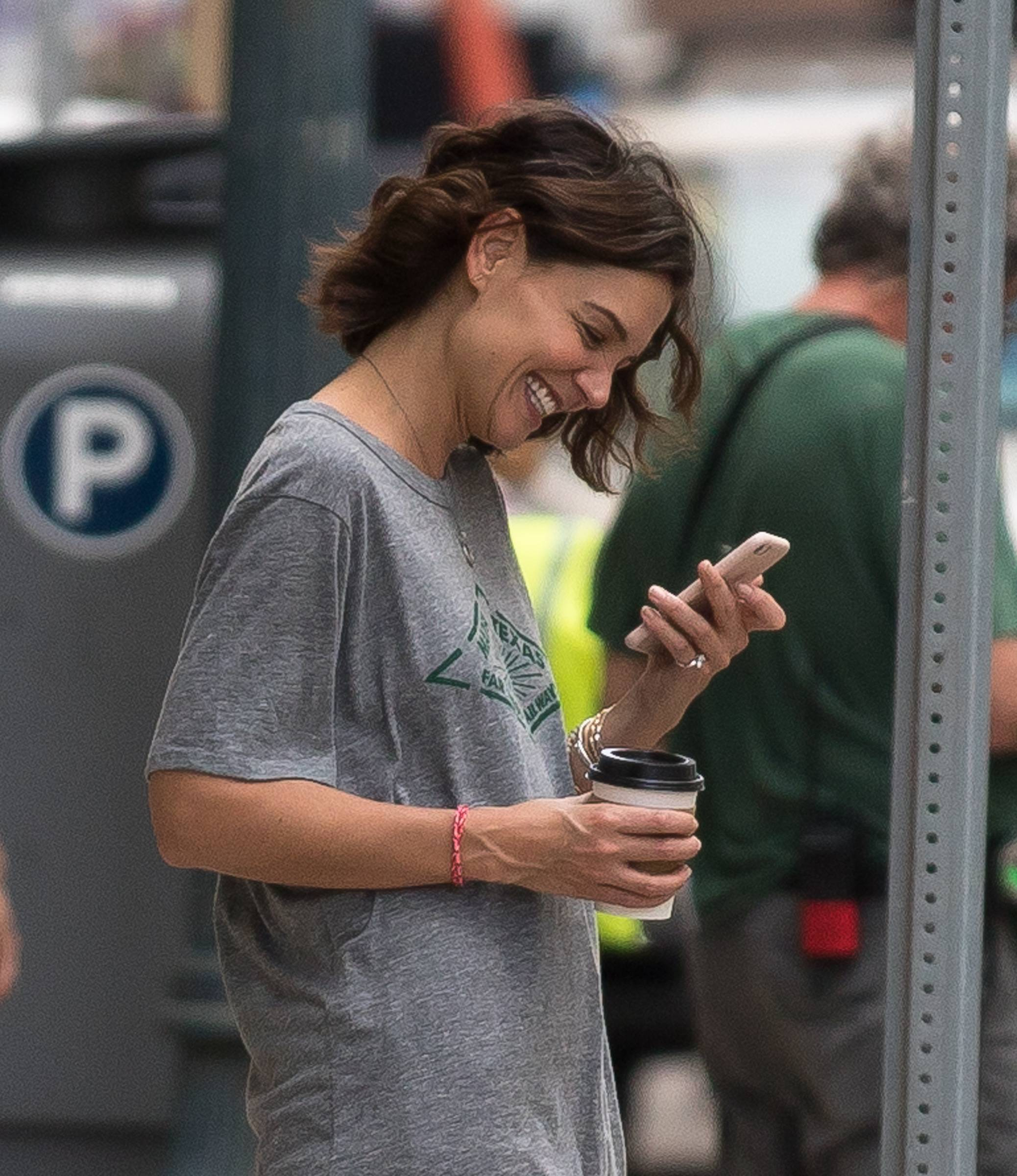 Katie Holmes - Now that Jamie Foxx and his boo Katie Holmesfinally out and proud, do we hear wedding bells in the near future? Katie was spotted walking around New Orleans with a big smile while wearing a diamond ring on her left pinky. Do you think she was wearing it on her pinky to throw people off the engagement trail? (Photo: Splash News)