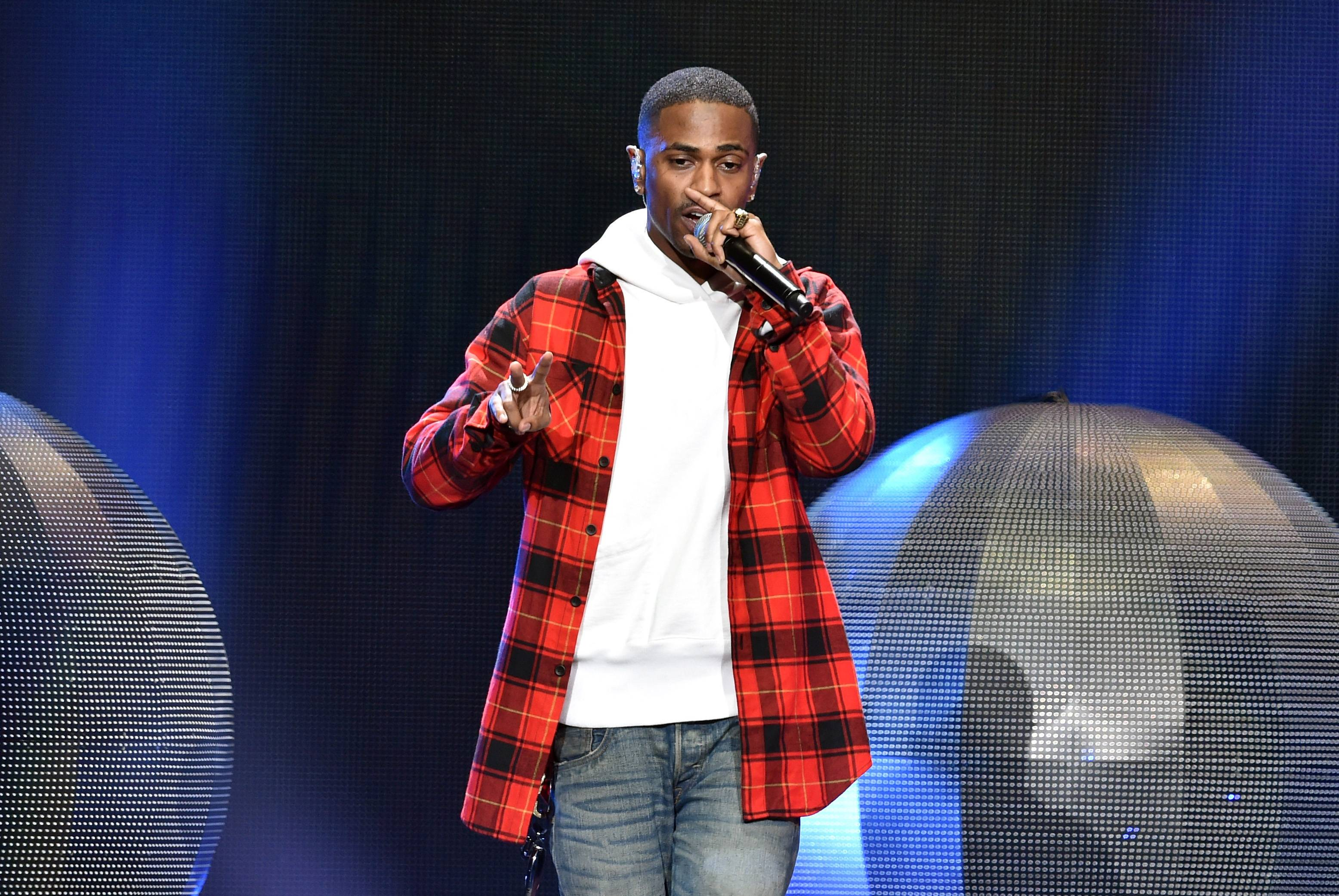 """Big Sean - Big Seanis one of those rare artists who can say he not only met, but signed with one of his favorite rappers. Recounting the impropmtu audition he had with Kanye at a Detroit radio station, Sean explained, """"I tapped him on the shoulder and was like, ?I?m an aspiring MC. I do this show every Friday. Can I rap for you?? He was like, ?No. I gotta go.? I?m like, ?Man, please ? you?re my hero...?? Sixteen seconds turned into a 10 minute showcase and Sean and Ye have been rolling like batman and Robin ever since.(Photo: Kevin Winter/Getty Images for iHeartMedia)"""