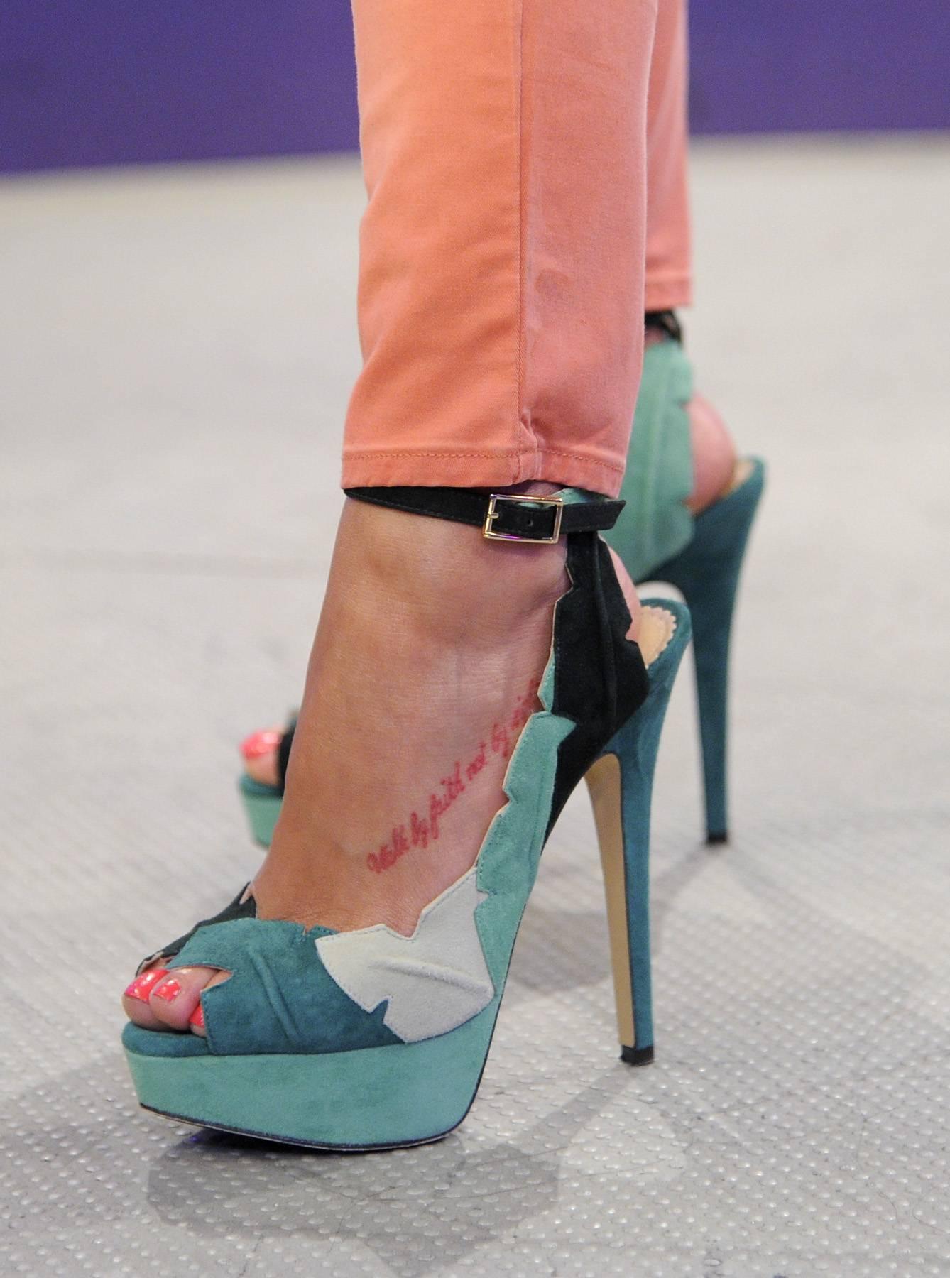 Stilts - Nobody rocks a pair of high, high, high heels like Rocsi does!(Photo: John Ricard/BET)