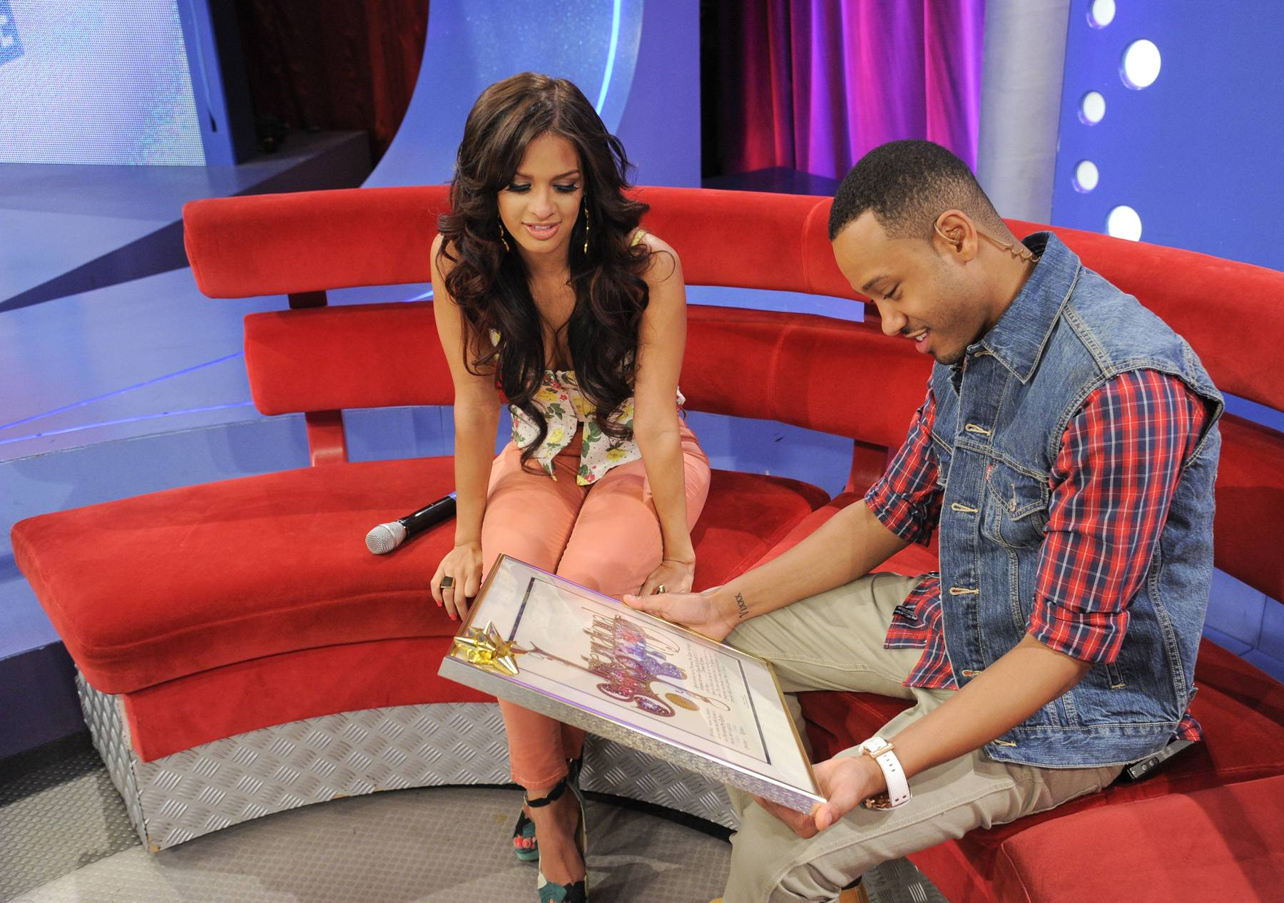 Moment to Examine - Terrence J and Rocsi Diaz check out his plaque stating that a star has been named for him, at 106 & Park, April 20, 2012. (Photo: John Ricard / BET)