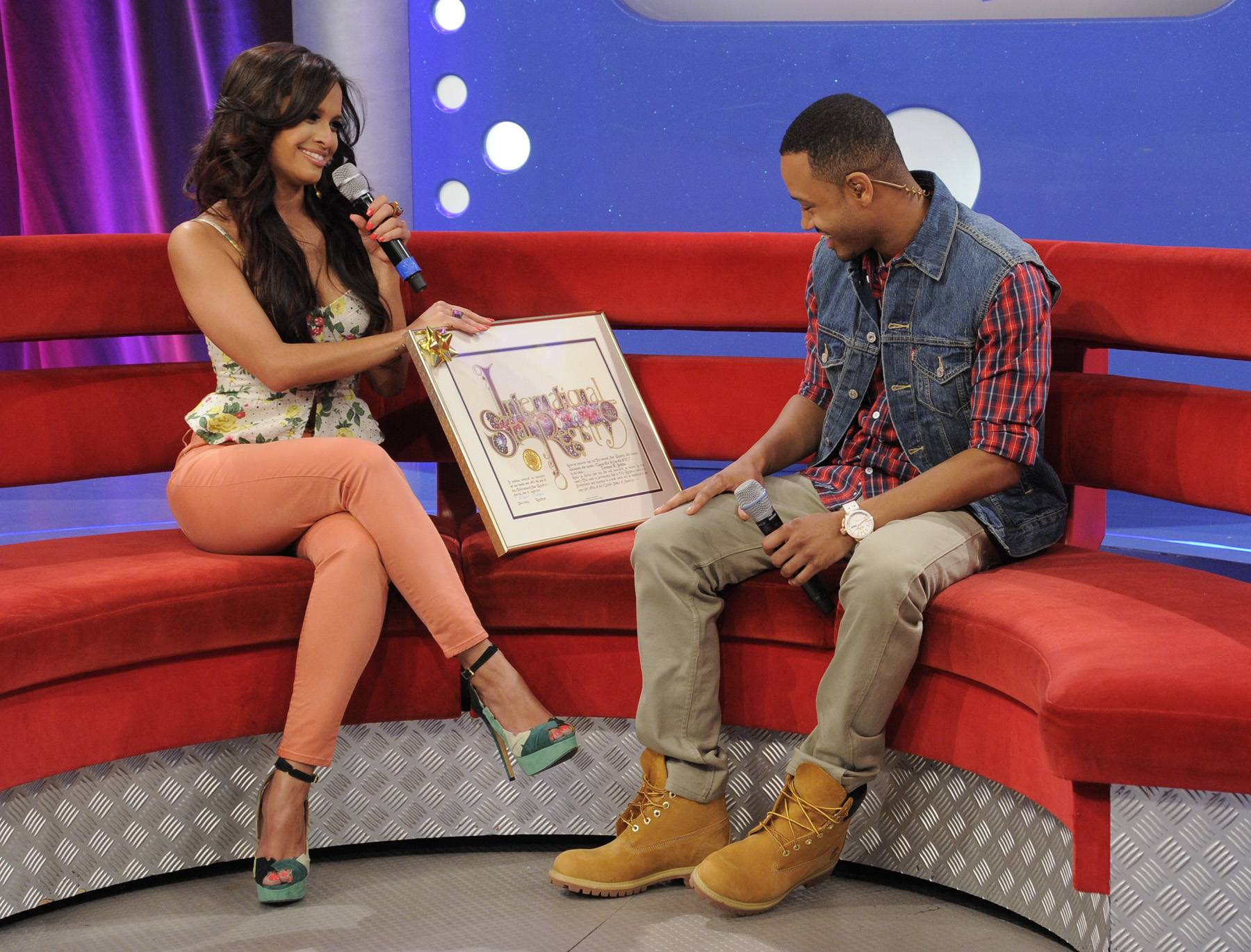 Presenting Something Special - Rocsi Diaz presents Terrence J with a plaque stating that a star has been named after him because he is a rising star at 106 & Park, April 20, 2012. (Photo: John Ricard / BET)