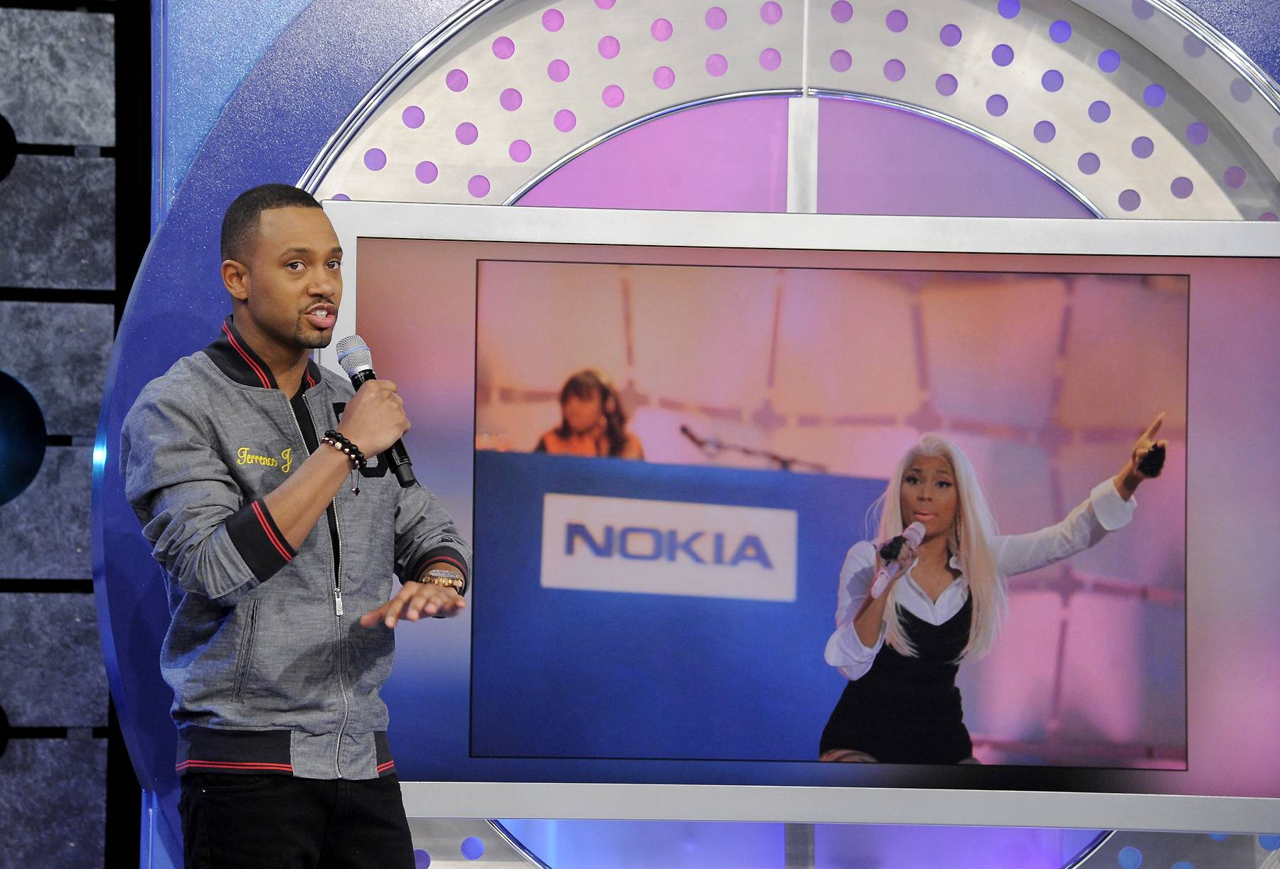 Call Me - Terrence J tells the audience about the recent surprise concert staged by Nicki Minaj at Times Square at 106 & Park, April 9, 2012. (photo: John Ricard / BET)