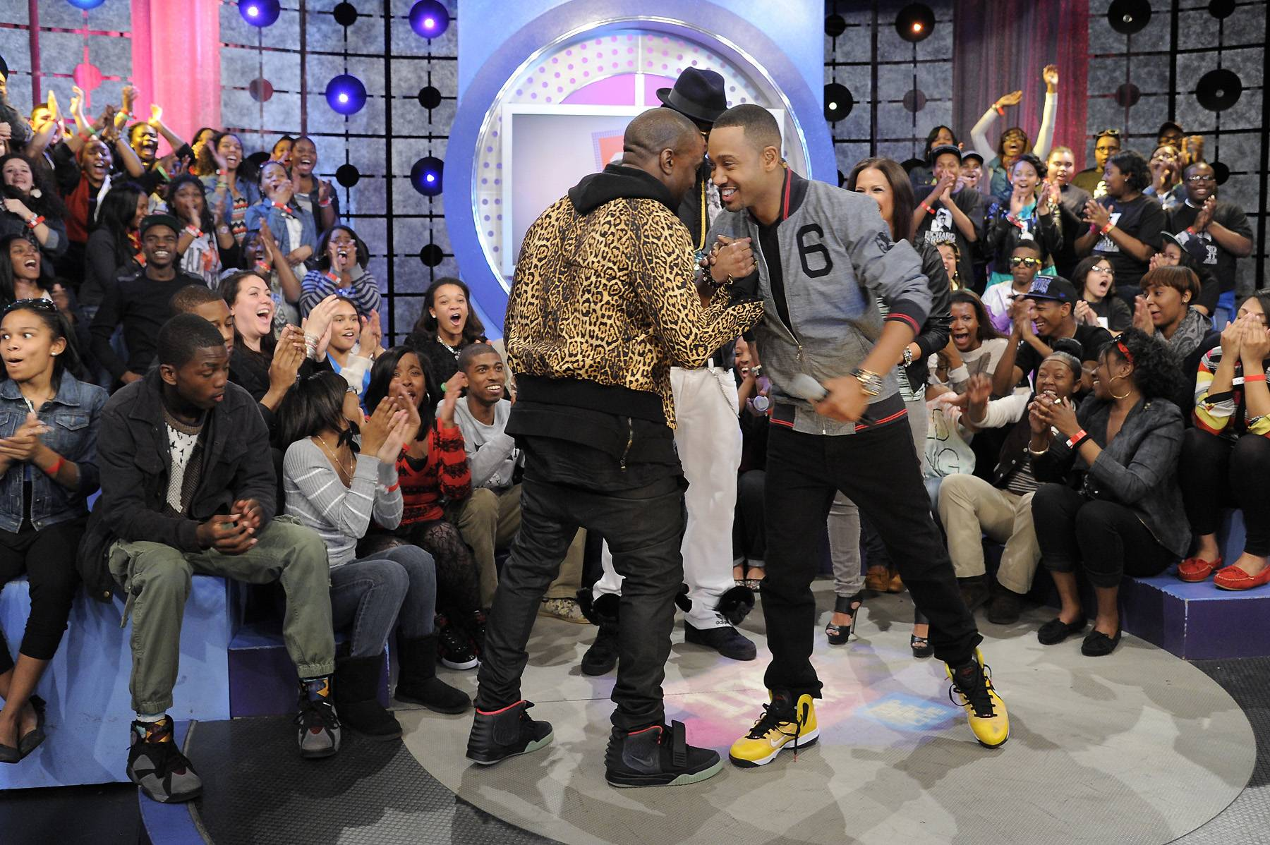 Good Music All Day - Kanye West greets Terrence J at 106 & Park, April 9, 2012. (photo: John Ricard / BET)