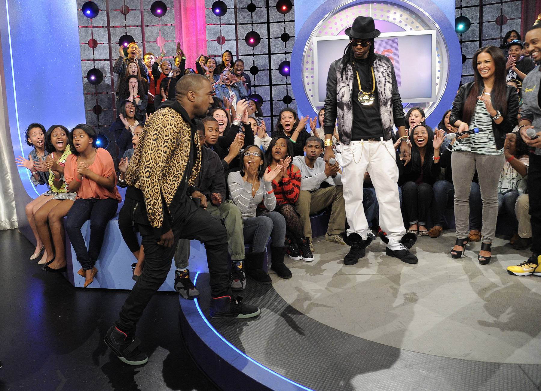 The Rumors Continue ? April 9, 2012 - Speculation continued that 2 Chainz was about to join the G.O.O.D. Music label when Kanye once again joined 2 Chainz, this time on 106 & Park. It was also here that Kanye showed off a pair of his Air Yeezy II?s, months before their release.(Photo: John Ricard/BET)