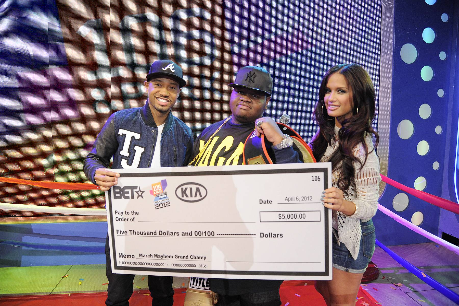 Hard Work Pays Off - Freestyle Friday champion Relly with $5,000 check from KIA at 106 & Park, April 6, 2012. (photo: John Ricard / BET)