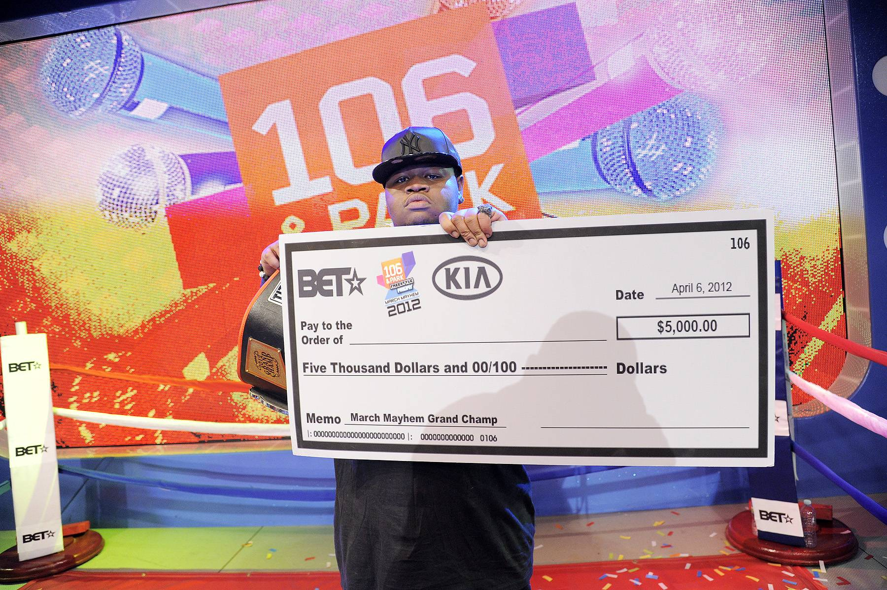 Best of the Best - Freestyle Friday champion Relly with $5,000 check from KIA at 106 & Park, April 6, 2012. (photo: John Ricard / BET)