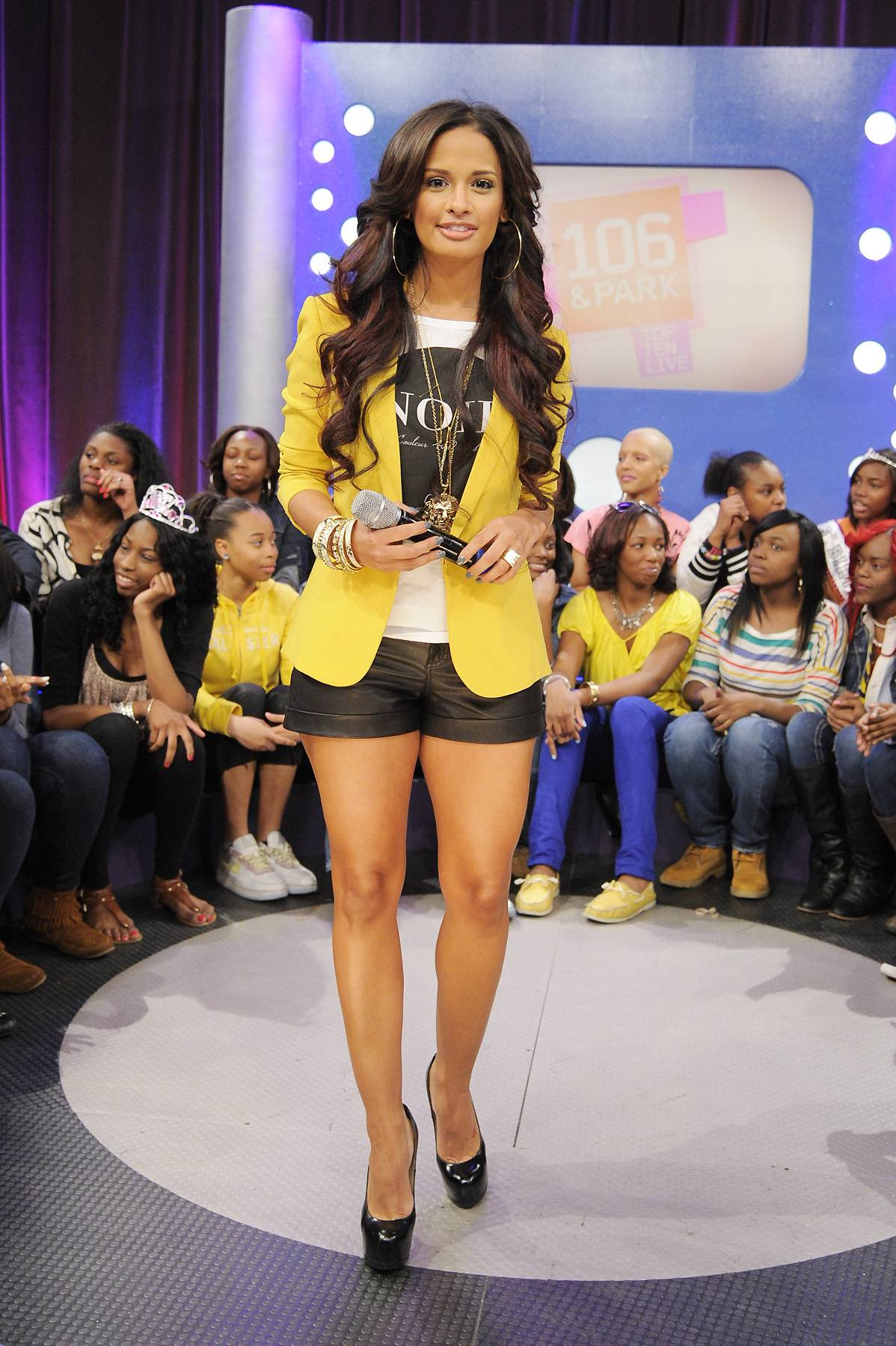 Rays of Sunshine - Leather shorts and a black and white tee can be so simple, but when it's glammed up with a yellow blazer, you know that you're dealing with a real fashionista!(Photo: John Ricard/BET)