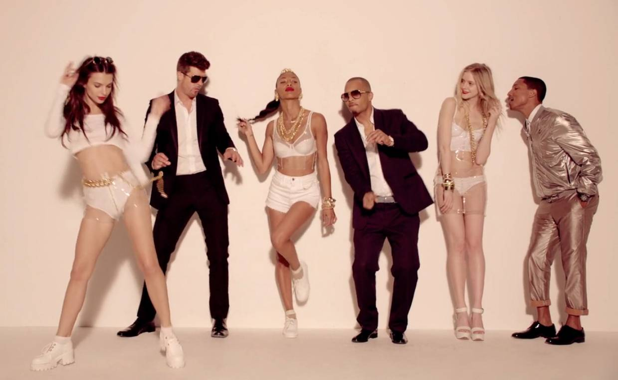 /content/dam/betcom/images/2013/06/Shows/BET-Awards/062113-shows-beta-road-to-the-bet-awards-ti-robin-thicke-pharrell-williams-blurred-lines.jpg