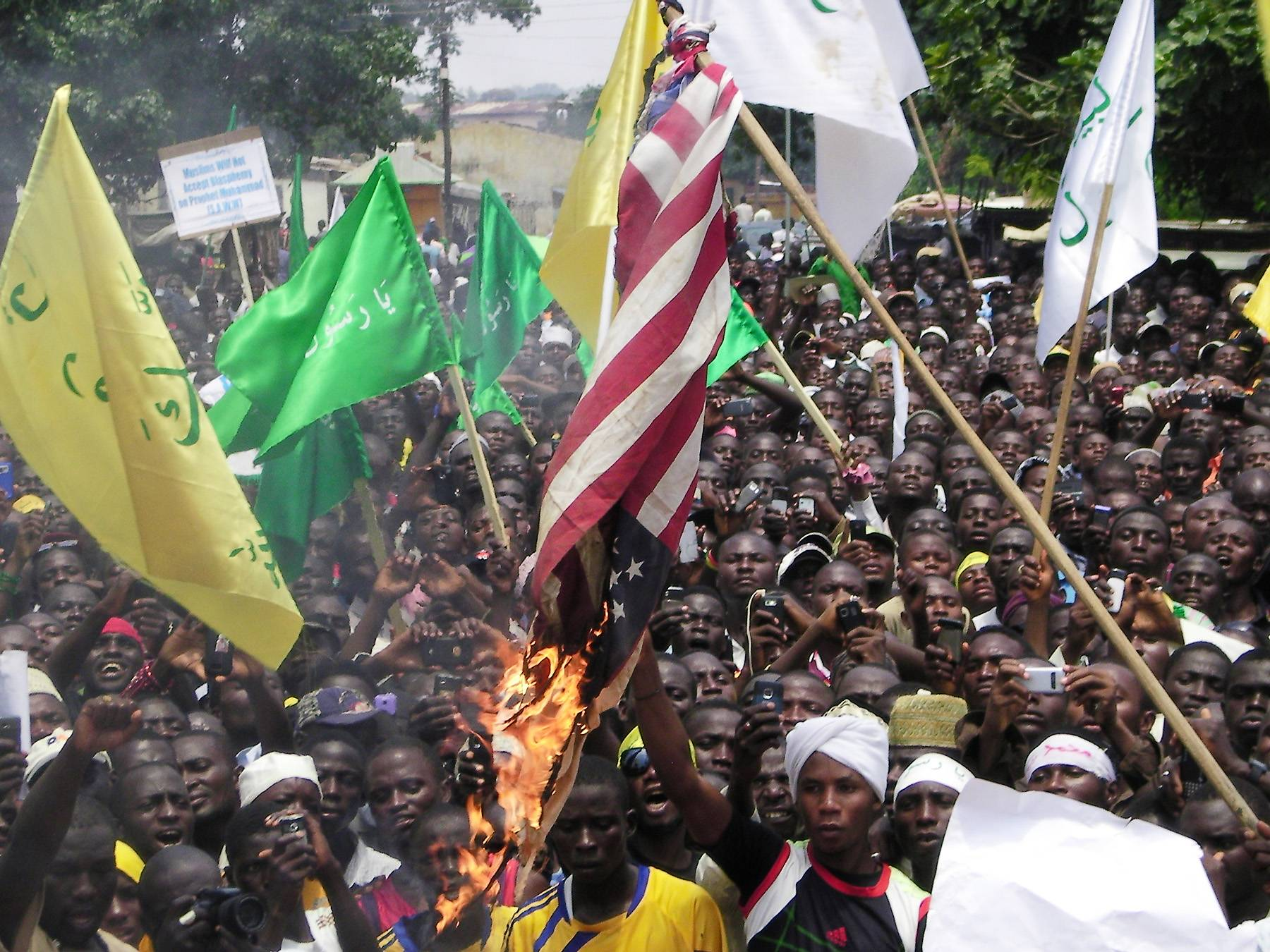 Nigeria Protests Anti-Islam Film - Nigeria was also hit by anti-Islam film protests as hundreds of protesters streamed through the streets of the largely Muslim northern city of Kaduna. (Photo: AP Photo/Godwin Attah)