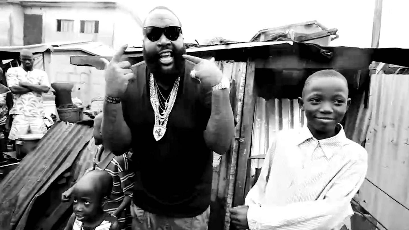 Rick Ross Releases Video Set in Nigerian Slum - Rick Ross released the latest version of his ?Hold Me Back? video. It is set in a poor section of Lagos, Nigeria, and features a random mix of images from the 1960s, modern day poverty and Nigeria?s performances in the 1994 World Cup and the 1996 Gold Medal Olympic final. (Photo: Maybach Music Group)