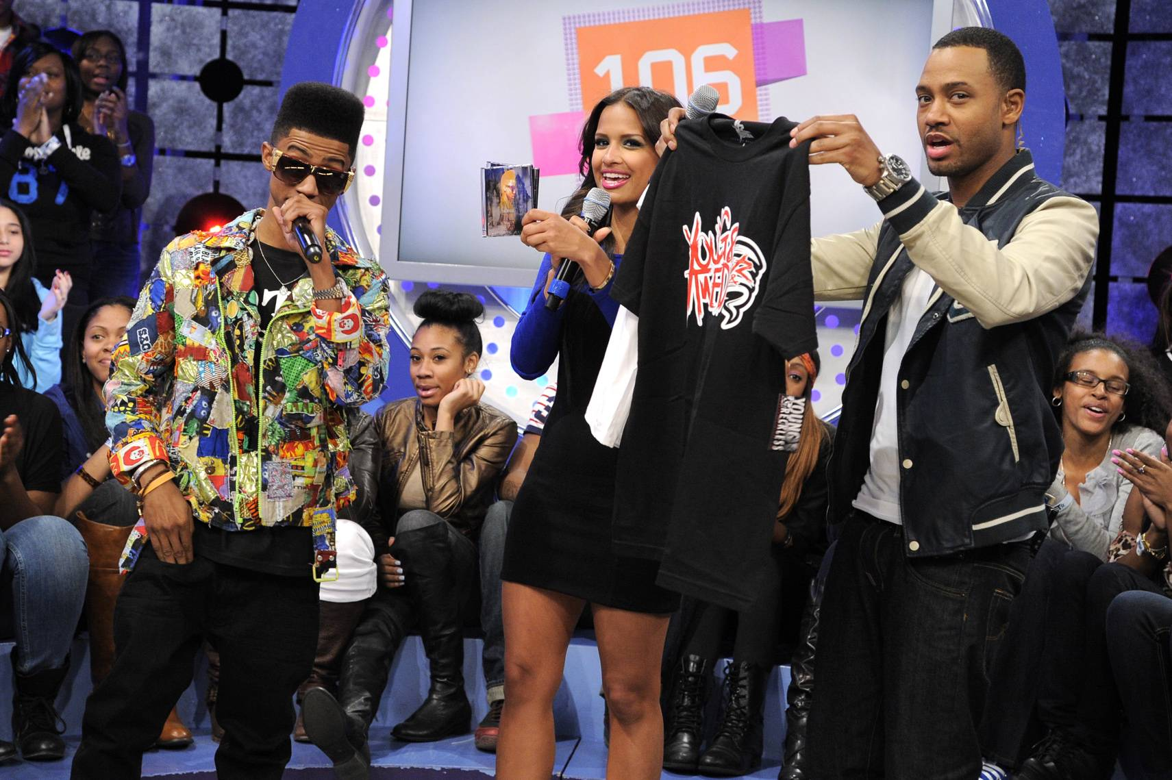 OK Now - Lil Twist presents shirts to Rocsi Diaz and Terrence J at 106 & Park, January 05, 2012. (Photo: John Ricard/BET)