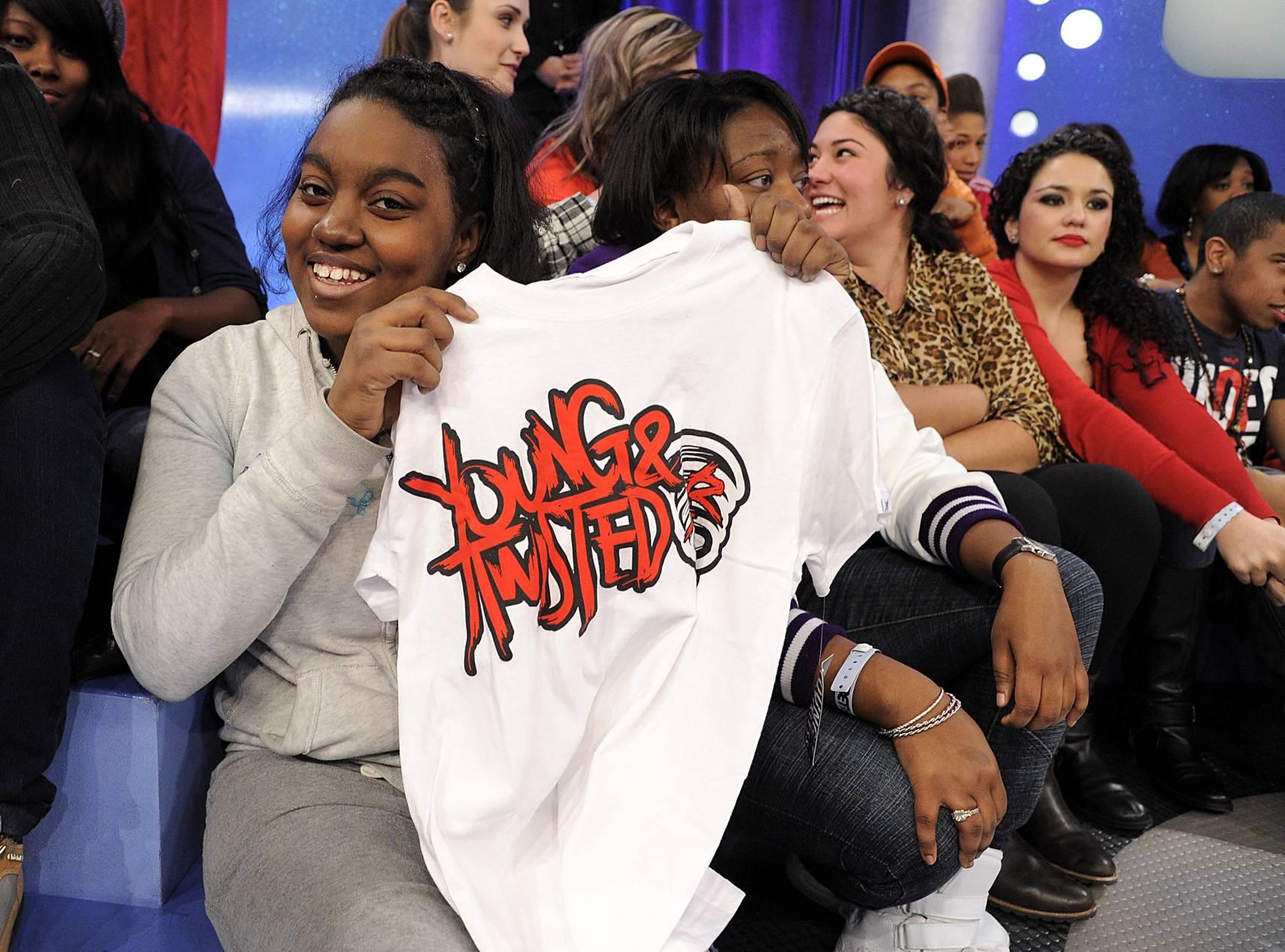 Nice Shirt - Fan displays Lil Twist shirt given to audience members at 106 & Park, January 05, 2012. (Photo: John Ricard/BET)