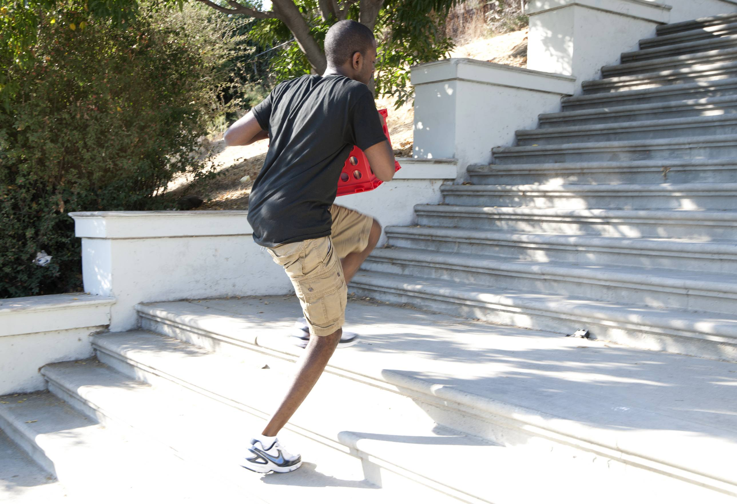 Lagging Behind - DJ M-Squared was struggling to carry the crates up the stairs. (Photo: Moses Mitchell/BET)