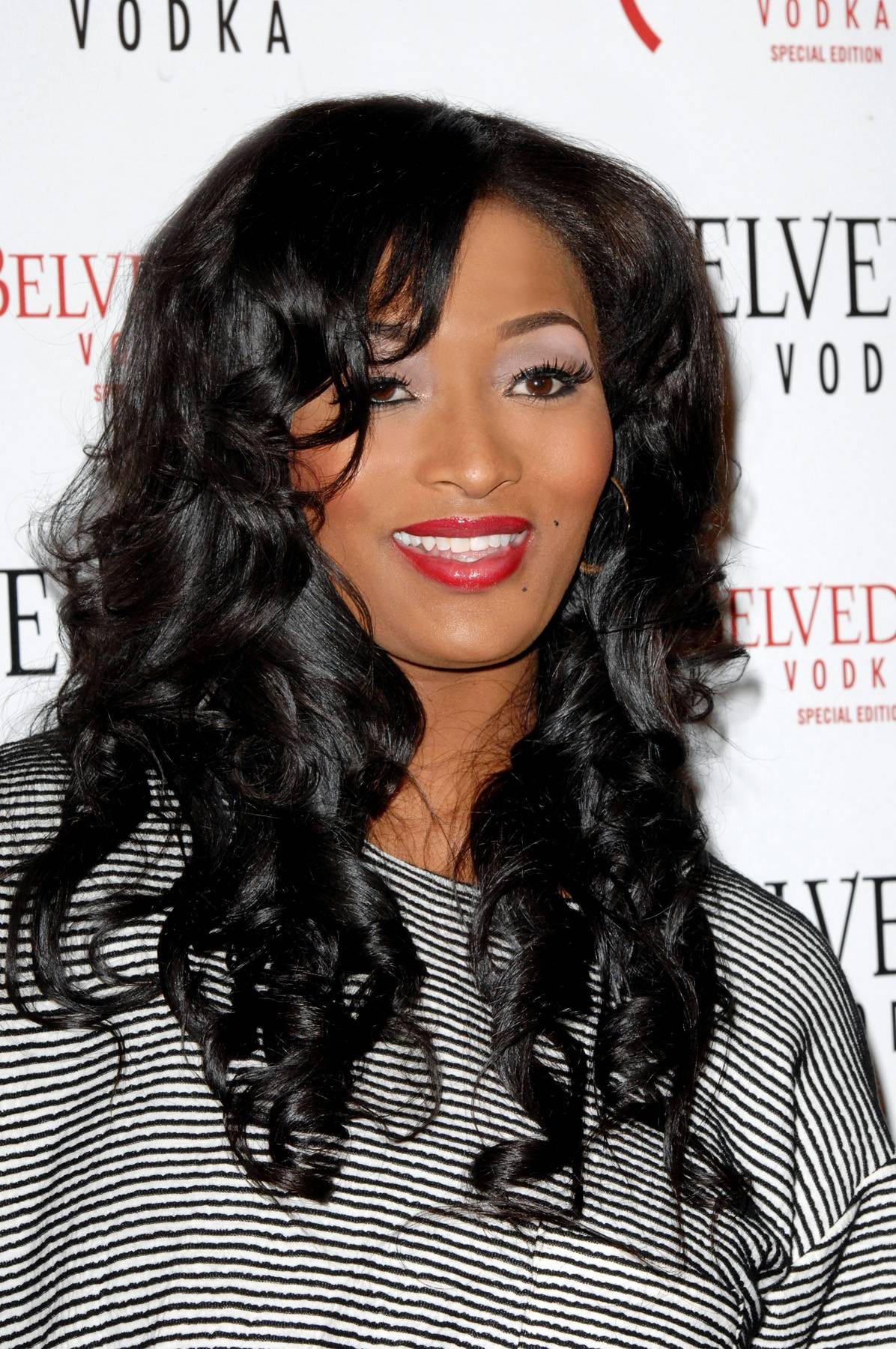 Toccara - Toccara keeps it bold and beautiful. ?It?s hard for us brown girls to find a nice red, but I like TIGI Bed Head Girls Just Want It lipstick in Luxury.?(Photo: Amanda Edwards/Getty Images)