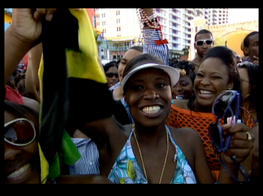 Jamaica, Stand Up! - One Spring Blinger reps her roots by waving a Jamaican flag during the step competition.