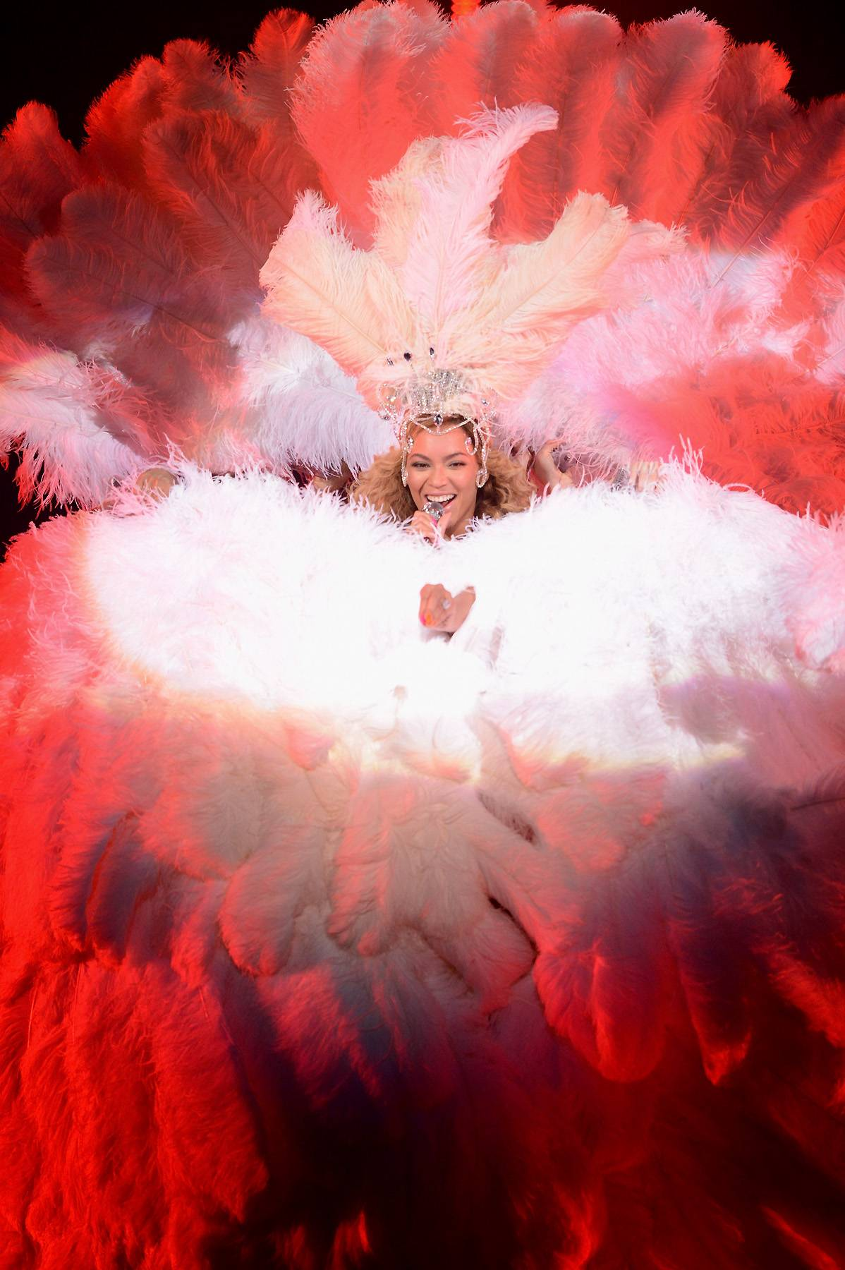 Show Stopper - Beyonc? channels her inner showgirl in a feathery costume while performing this weekend at Atlantic City?s newly launched Revel resort in her first concerts since giving birth to daughter Blue Ivy.  (Photo: Kevin Mazur/WireImage)