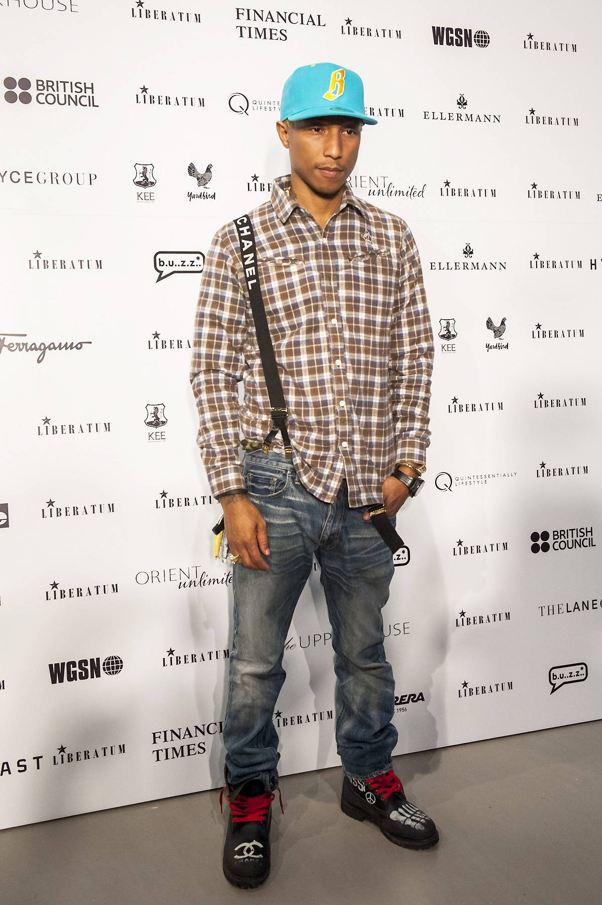 """Pharrell Williams - Between the clothing lines Billionaire Boys Club and Ice Cream, Pharrell is no stranger to fashion. He was one of the first rappers to bring skate culture to hip hop and diversify the typical rap """"look.""""(Photo: Victor Fraile/Getty Images)"""