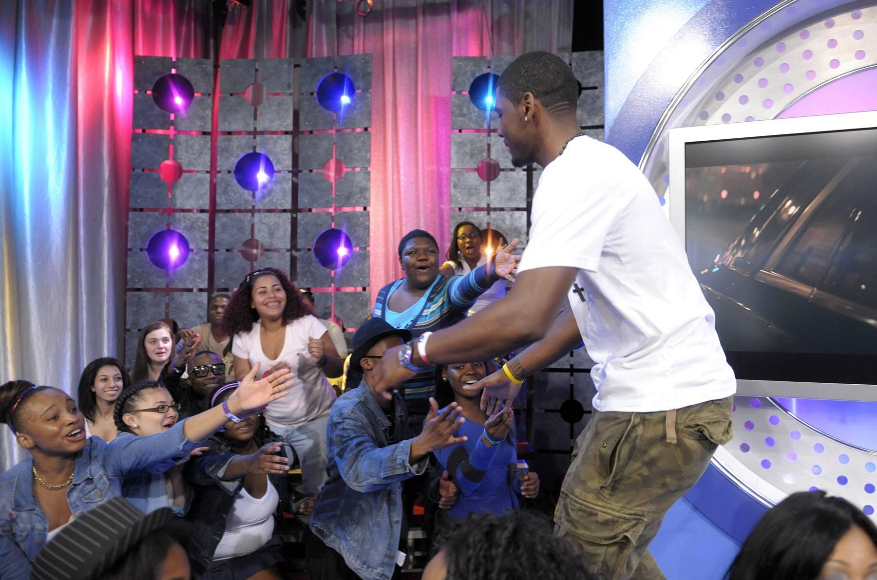 Wats good? - Kyrie Irving greets audience members at 106 & Park, May 16, 2012. (Photo: John Ricard / BET)