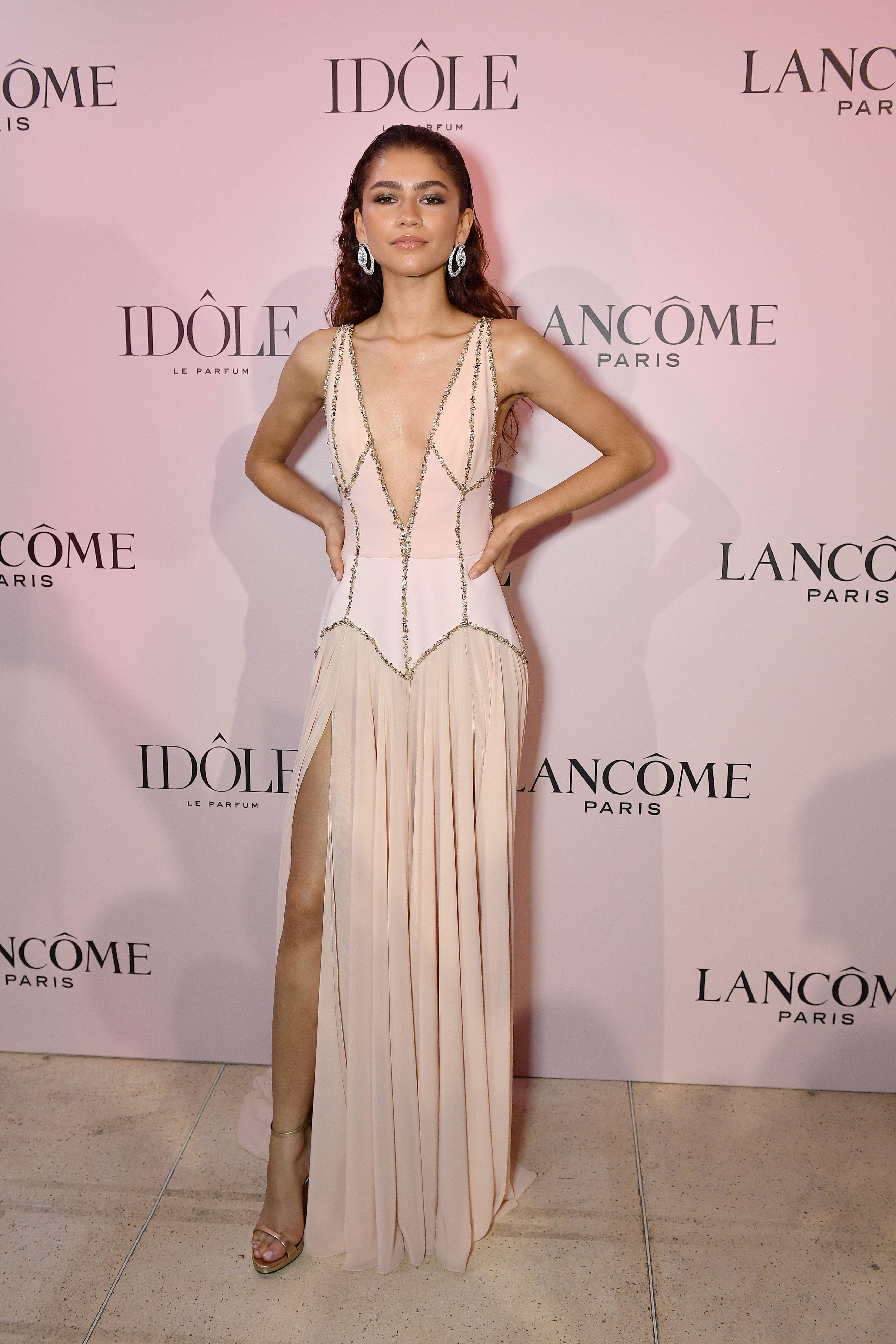 """Zendaya Glows As The Face OfLancôme Idôle - In Paris, Zendaya made quite a debut as the face of the new Lancôme """"Idôle"""" fragrance on Tuesday (June 2). Styled by Luxury Law, the 22-year-old actress looked stunning in a blush-pink Georges Hobeika gown with bold plunging neckline.(Photo: Kristy Sparow/Getty Images for Lancome)"""
