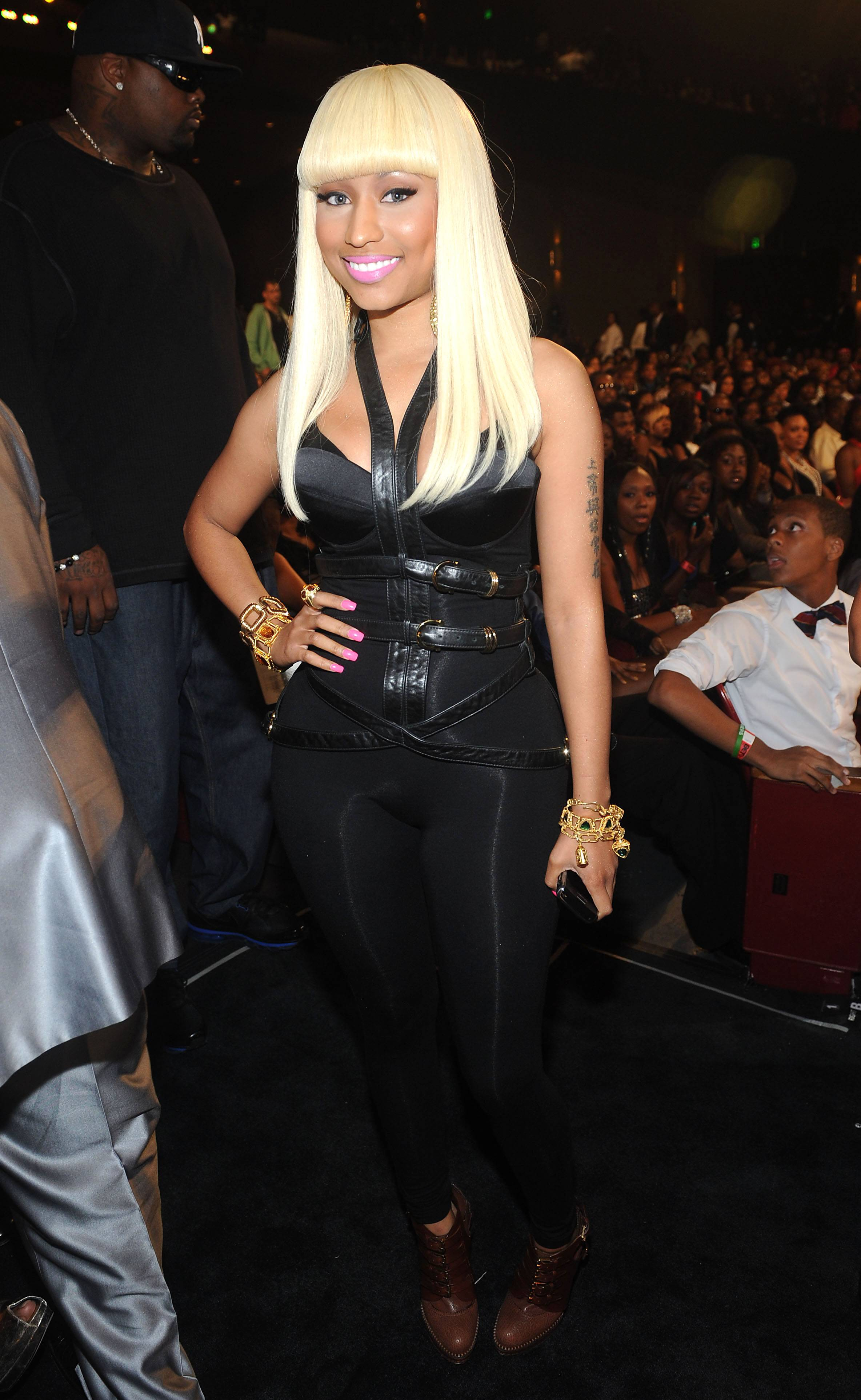 """""""Super Bass"""" Hits No. 1, Solidifies Nicki's Spot in the Game - Although Nicki'sPink Friday was a record-breaking success that spawned several hits, it wasn't until June 2011 that she scored her first solo Top 10 hit with """"Super Bass,"""" off the deluxe version of the LP. The accomplishment solidified the rapstress' potential for longevity.(Photo: Brad Barket/PictureGroup)"""