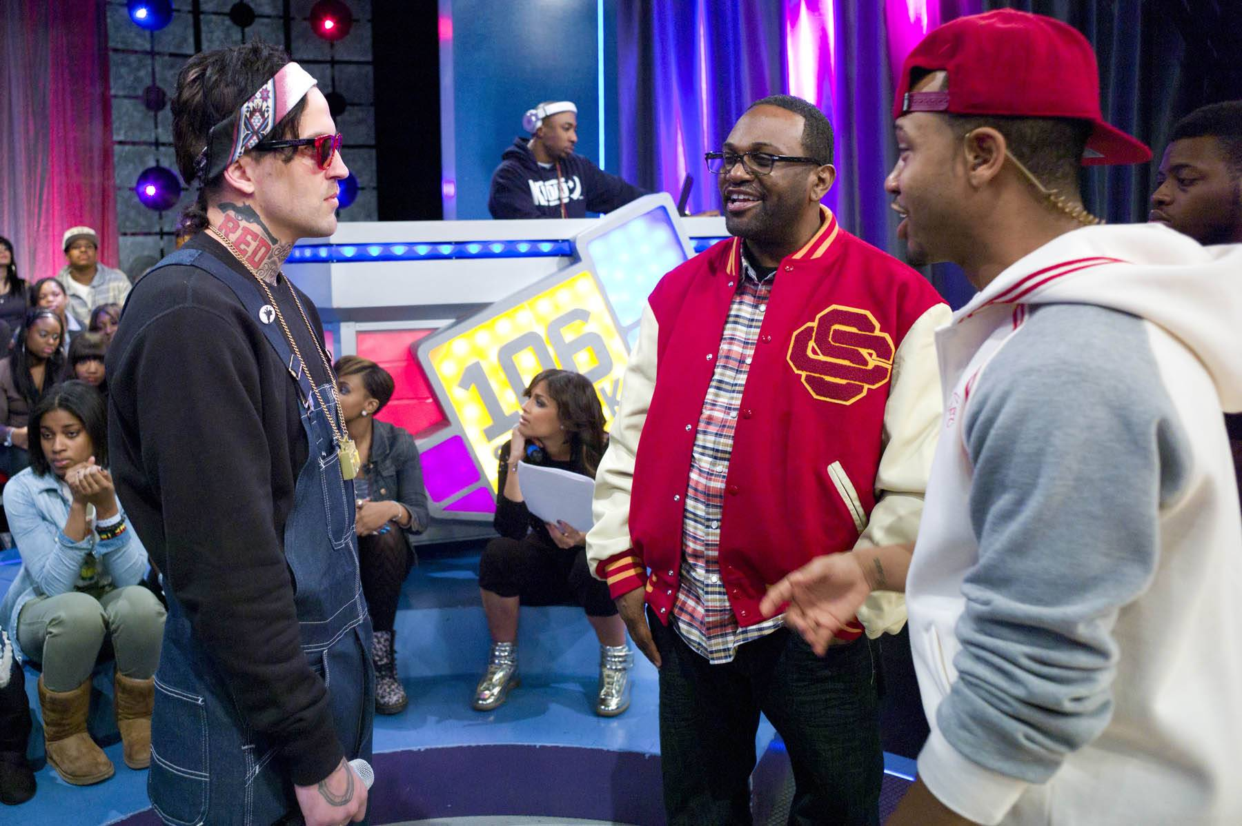 Cool Bro - Yelawolf and Terrence J are joined by Mike Cole of Universal Records during commercial break at 106 & Park, January 27, 2012. (Photo: John Ricard / BET)