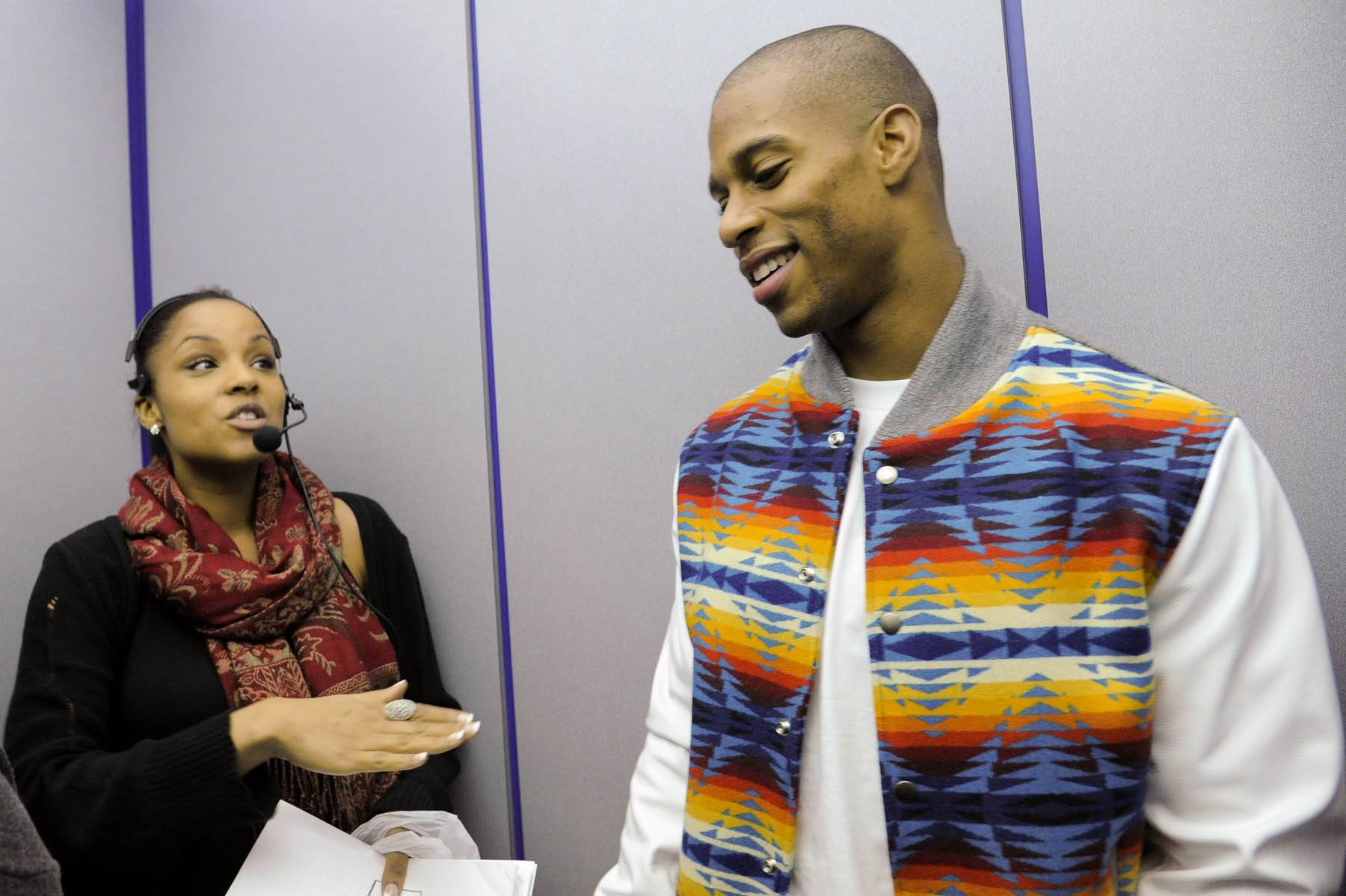 Tell Me About It - NY Giants wide receiver Victor Cruz talks with show producer Stephanie at 106 & Park, January 26, 2012. (Photo: John Ricard / BET)